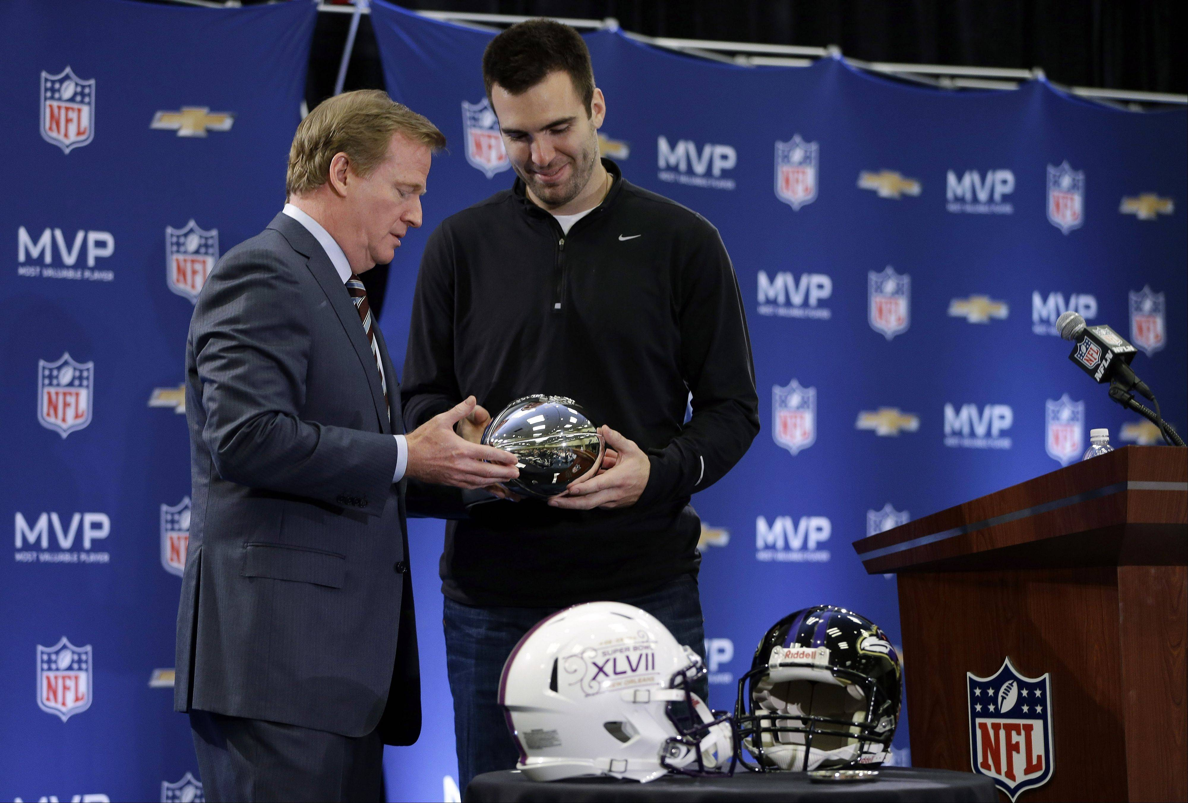 NFL Commissioner Roger Goodell hands the MVP trophy to Baltimore Ravens quarterback Joe Flacco at a news conference Monday after Super Bowl XLVII in New Orleans. The Ravens defeated the San Francisco 49ers 34-31.