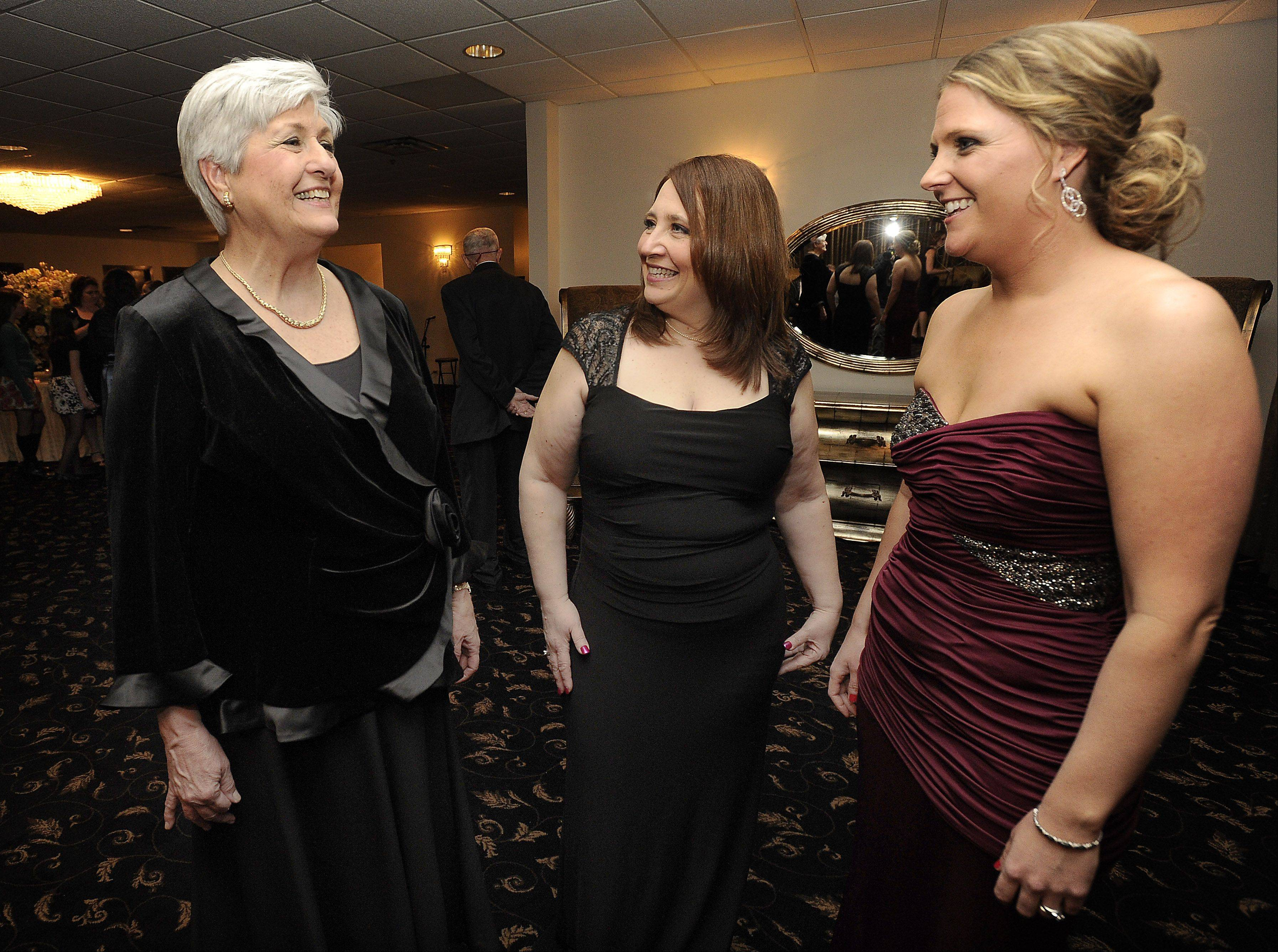 Christina Greco, Shining Star presenter, center, and Teresa VanOpdorp, chairman of the Celestial Celebration, right, speaks with Mount Prospect Mayor Irvana Wilks at the gala last Friday.