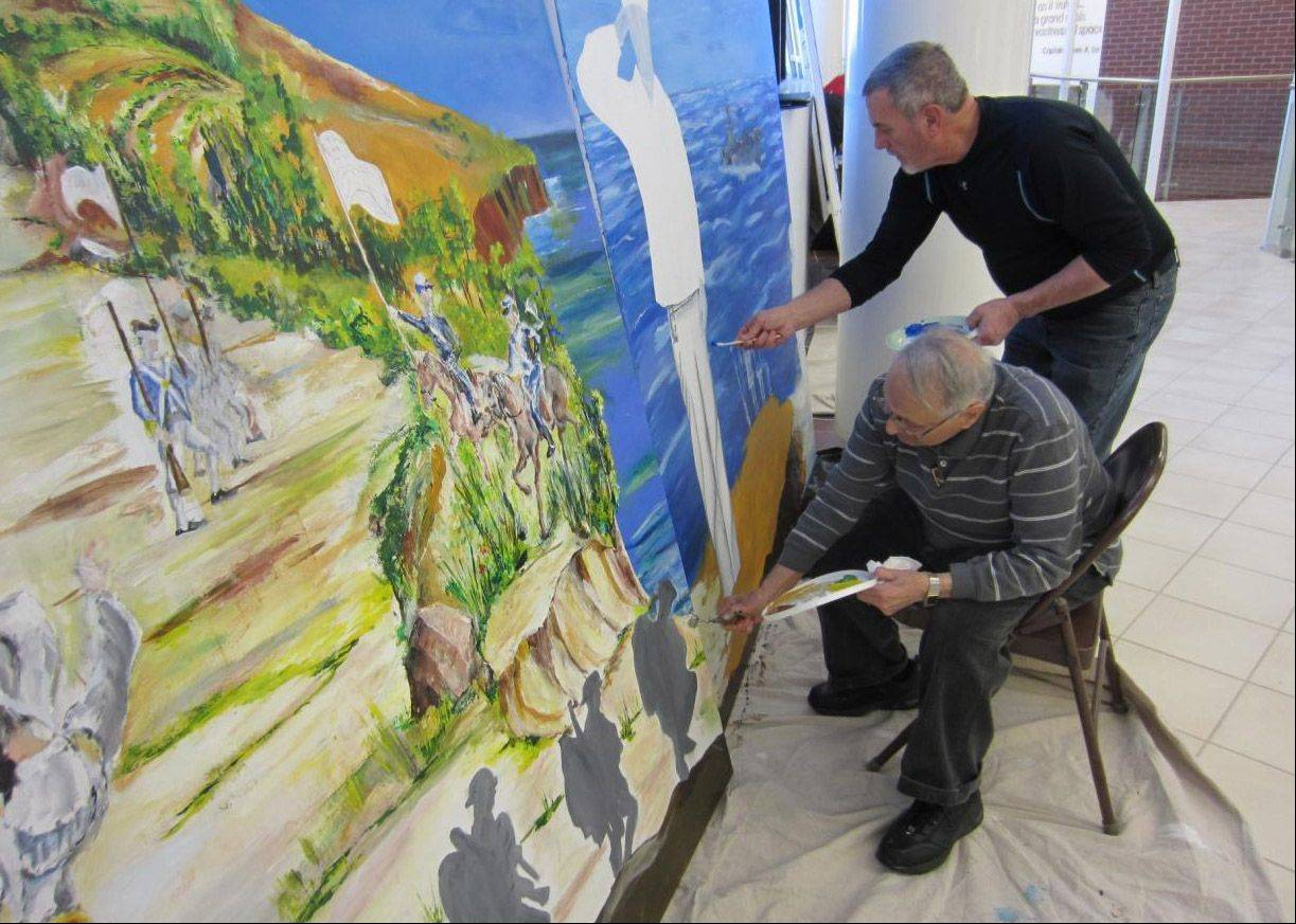 Veteran Howard Jacobs, who was drafted into service in World War II from Highland Park and still resides there, paints in the foreground. Jacobs painted the section on the left, depicting the Revolutionary War, the first of the military conflicts to be portrayed in the mural. Vietnam veteran Dave Watling, Pleasant Prairie, Wis., paints to his right.