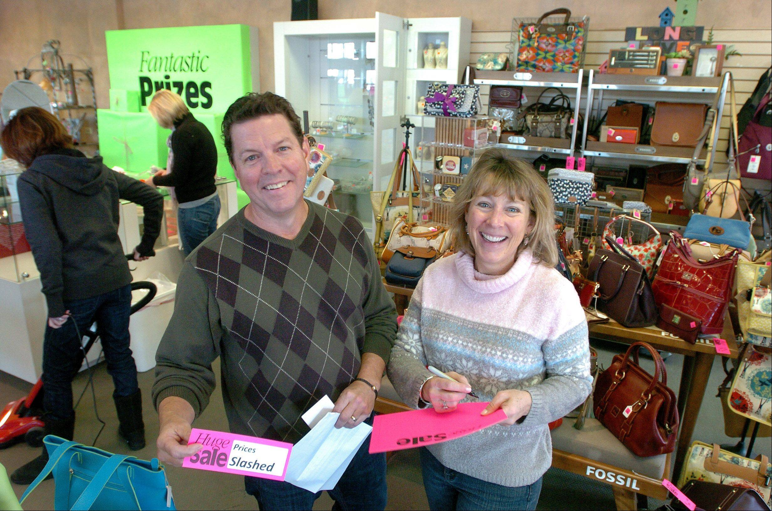 Bob and Jan Cunningham, owners of G. Whiz, a long-time gift store at The Foundry in Barrington, are closing its doors.
