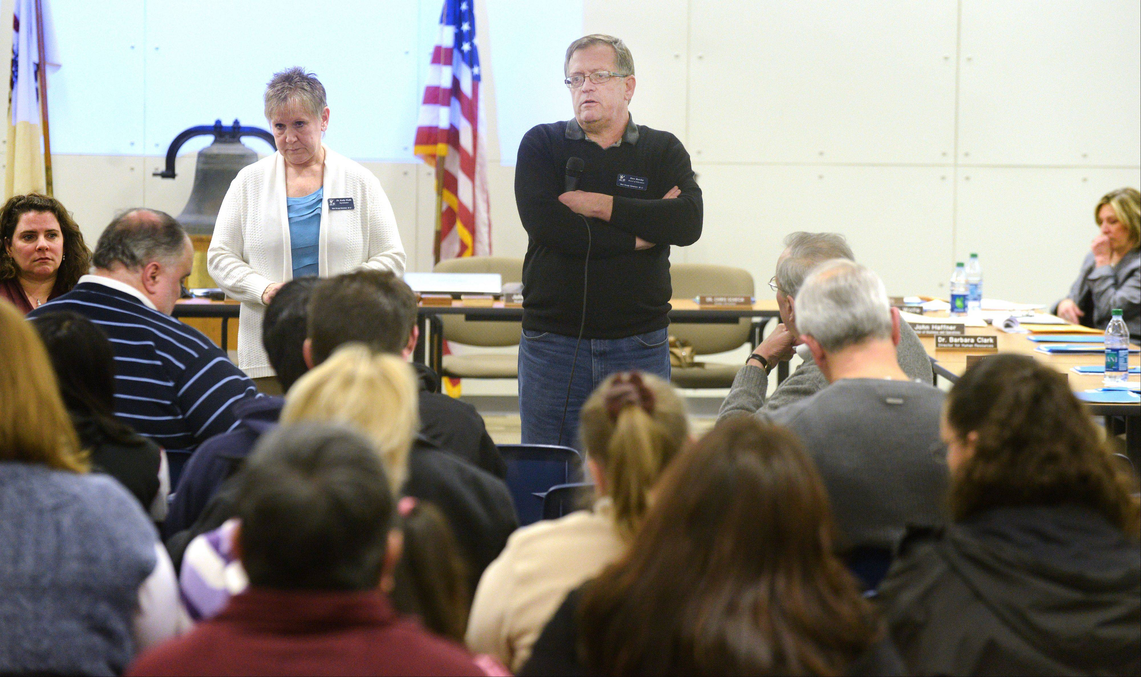 West Chicago District 33 school board spokesman Dave Barclay talks to about 60 parents Thursday during a special board meeting as he and Interim Superintendent Kathy Wolfe answer questions about a tentative contract with teachers reached early that morning.
