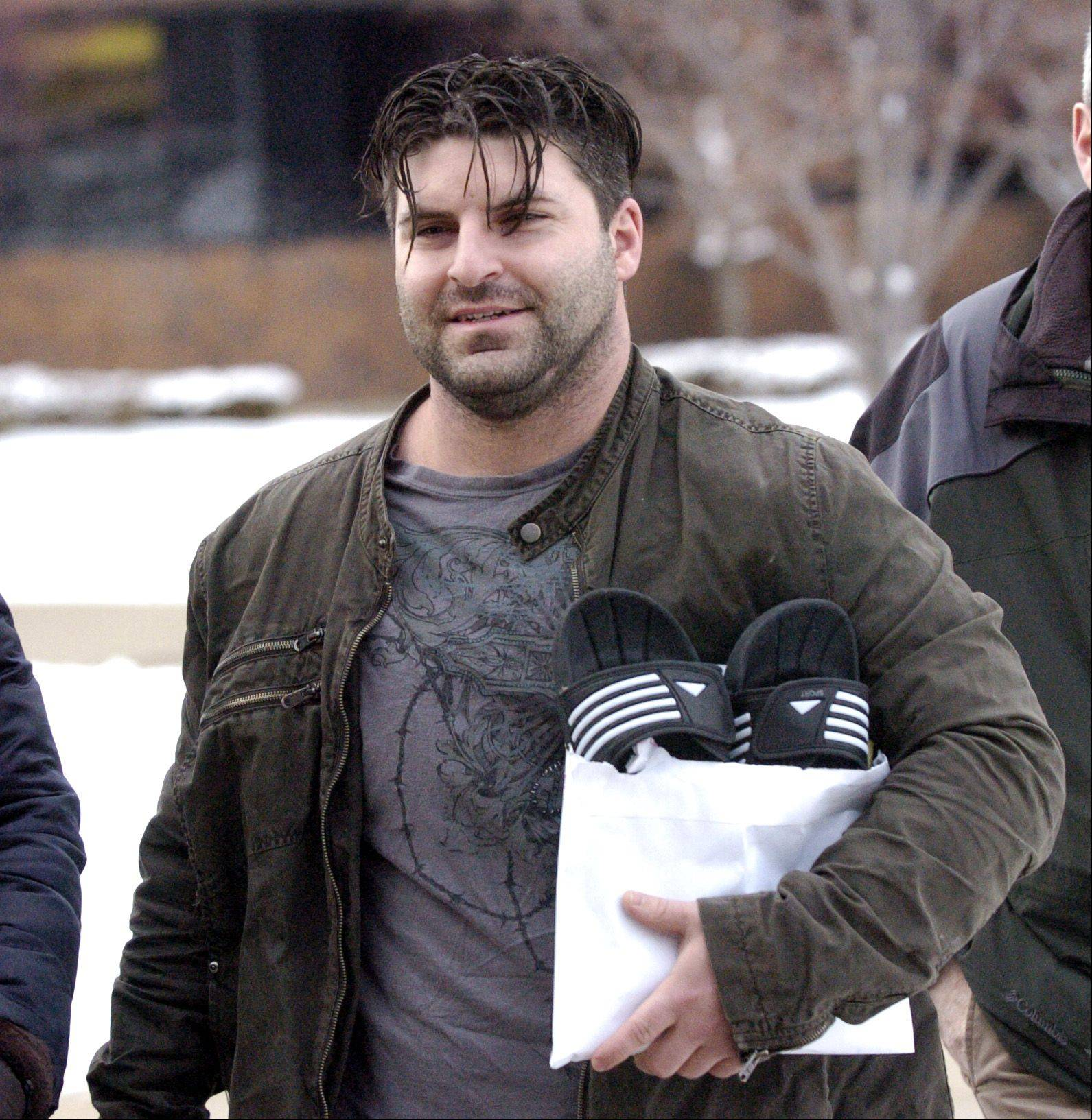 Former Schaumburg police officer Matthew Hudak leaves DuPage County Jail after posting bond Monday.
