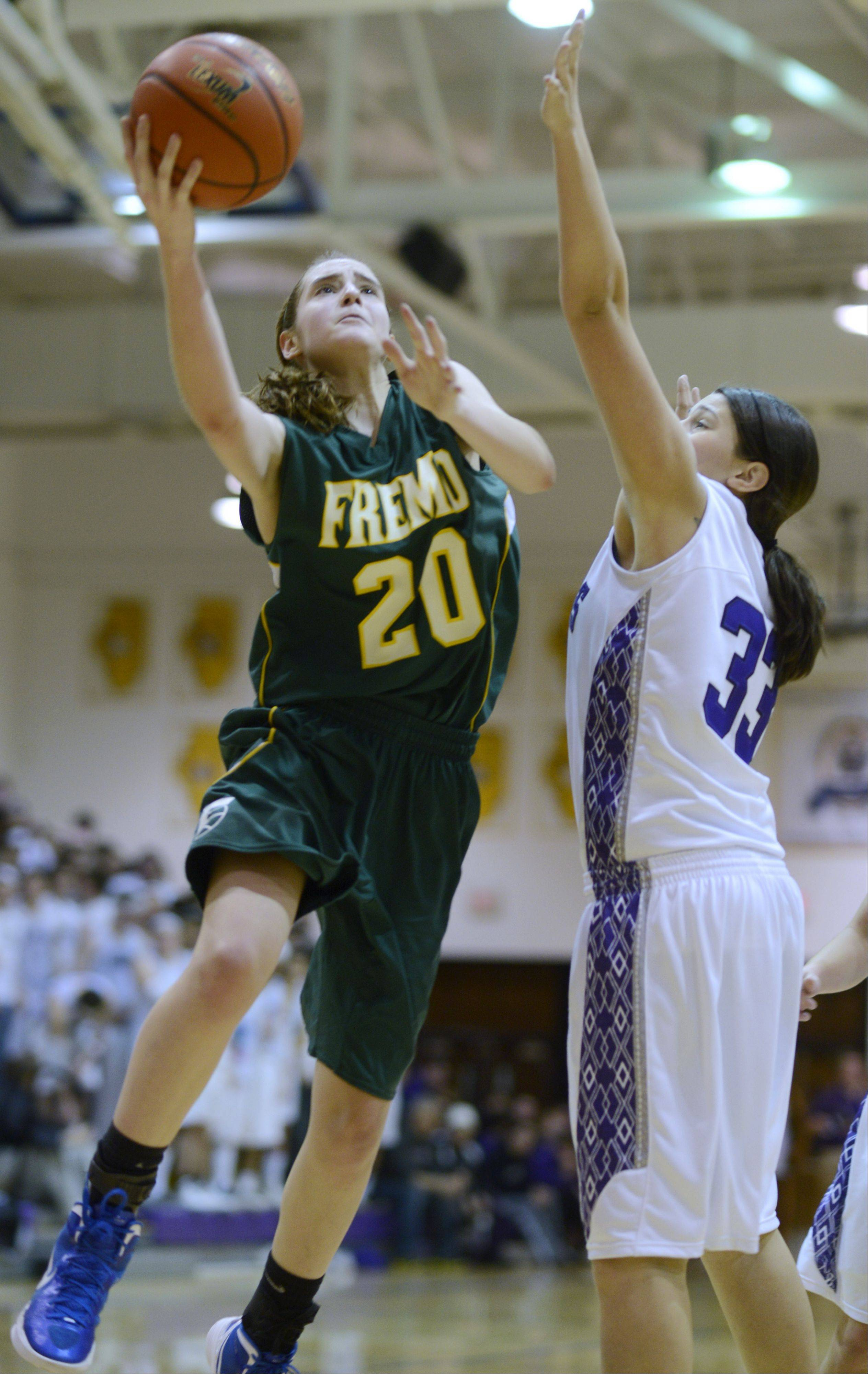Fremd�s Haley Gorecki drives for a layup against Rolling Meadows defender Ashley Montanez during the Mid-Suburban league championship game Wednesday.