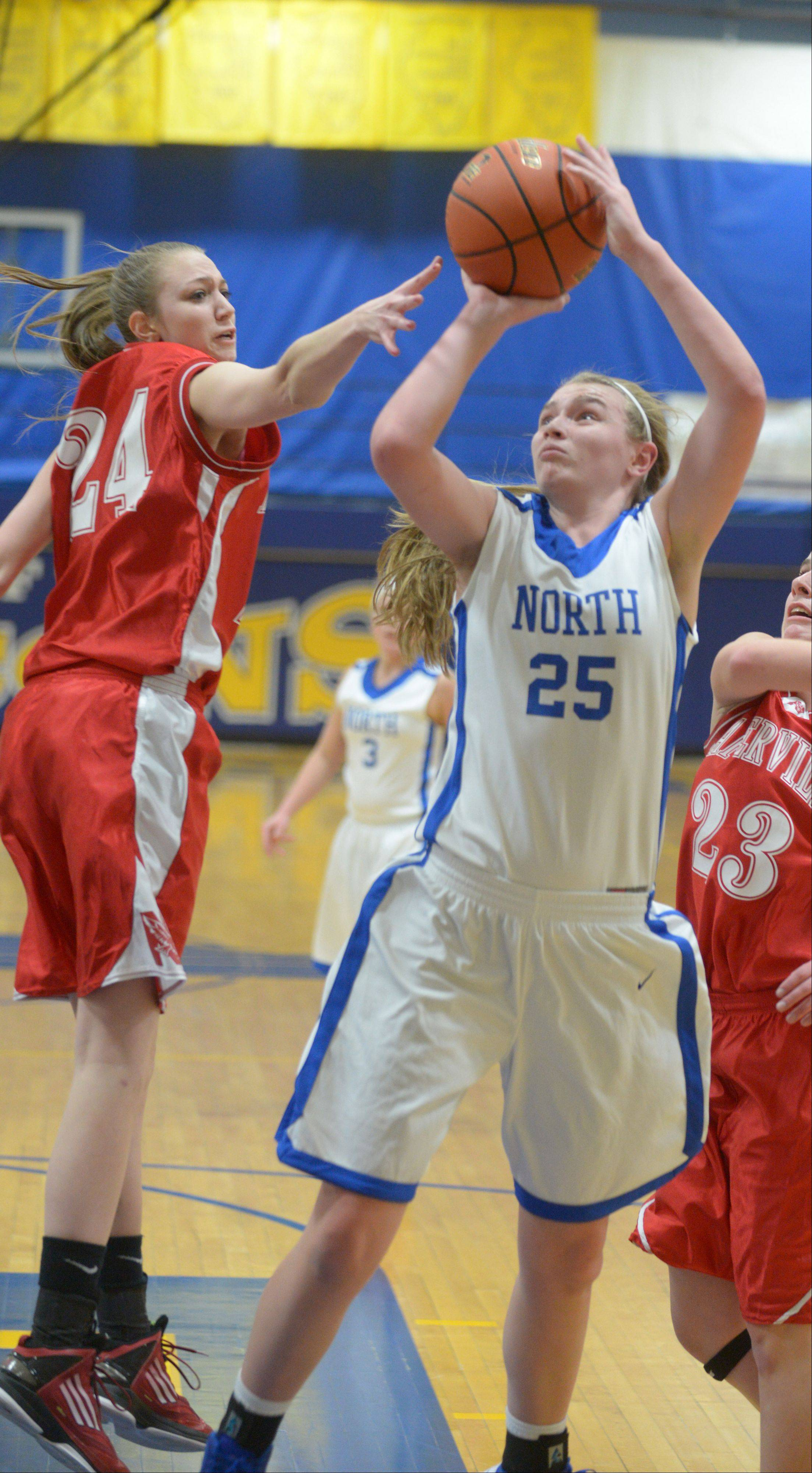 Wheaton North's Mandy Traversa (23) shoots over Jamie Cuny of Naperville Central recently. Wheaton North is the Chicago Sky Girls High School Basketball Team of the Week.