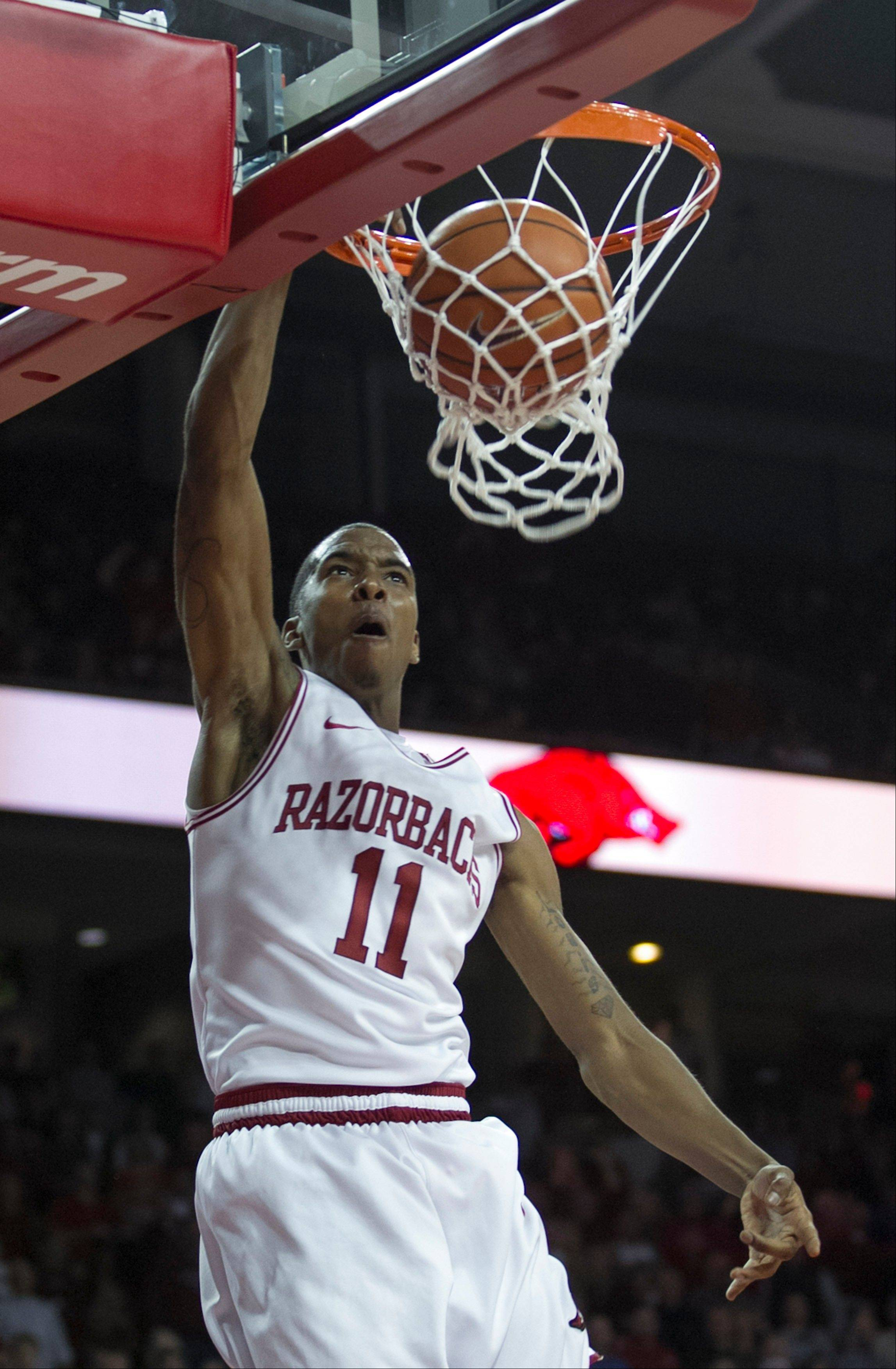 Arkansas' BJ Young (11) dunks during the second half an NCAA college basketball game against No. 2 Florida in Fayetteville, Ark., Tuesday Feb. 5, 2013. Arkansas won 80-69. (AP Photo/Gareth Patterson)