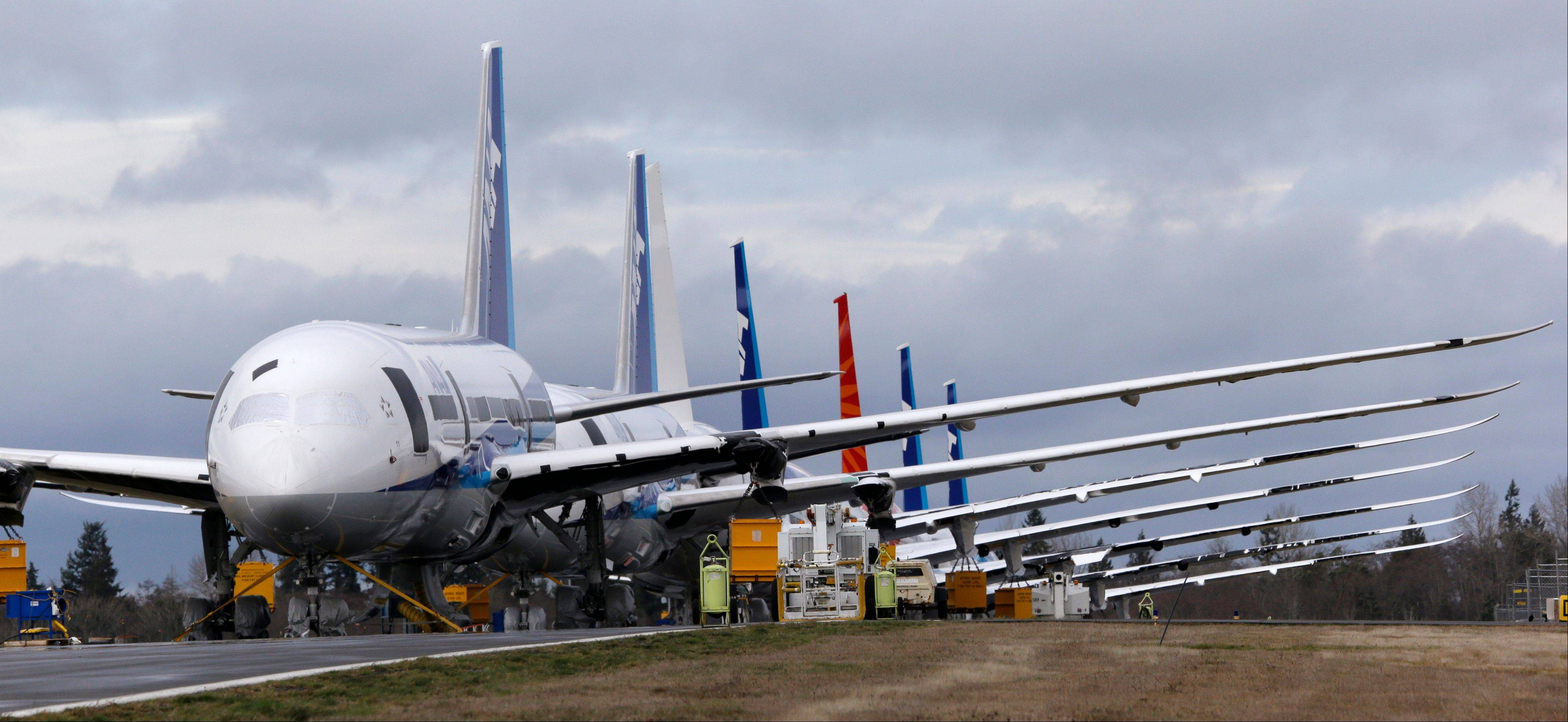 A line of Boeing 787 jets are parked Tuesday at Paine Field in Everett, Wash.