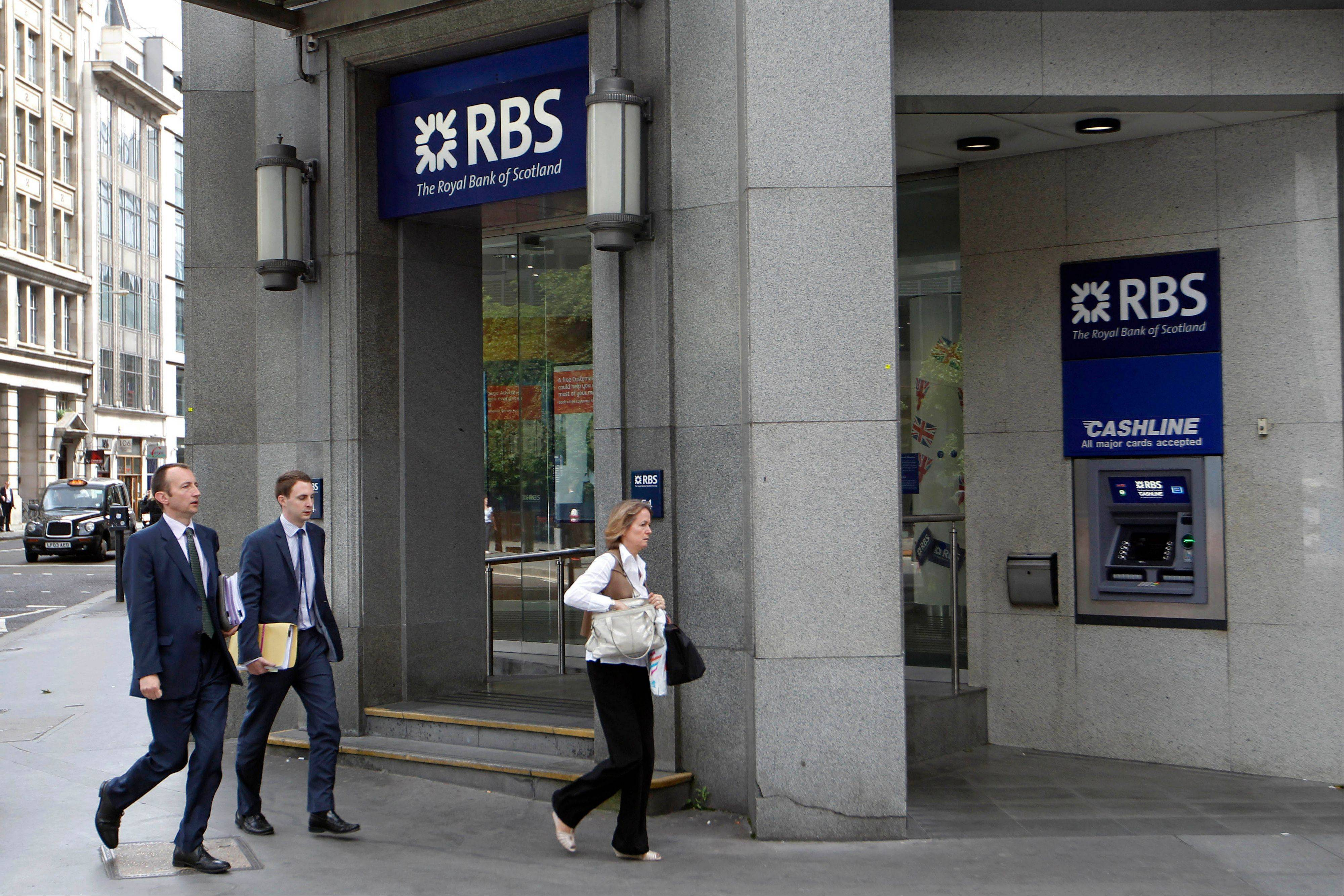 People walk by a branch of Royal Bank of Scotland (RBS) in the City of London.