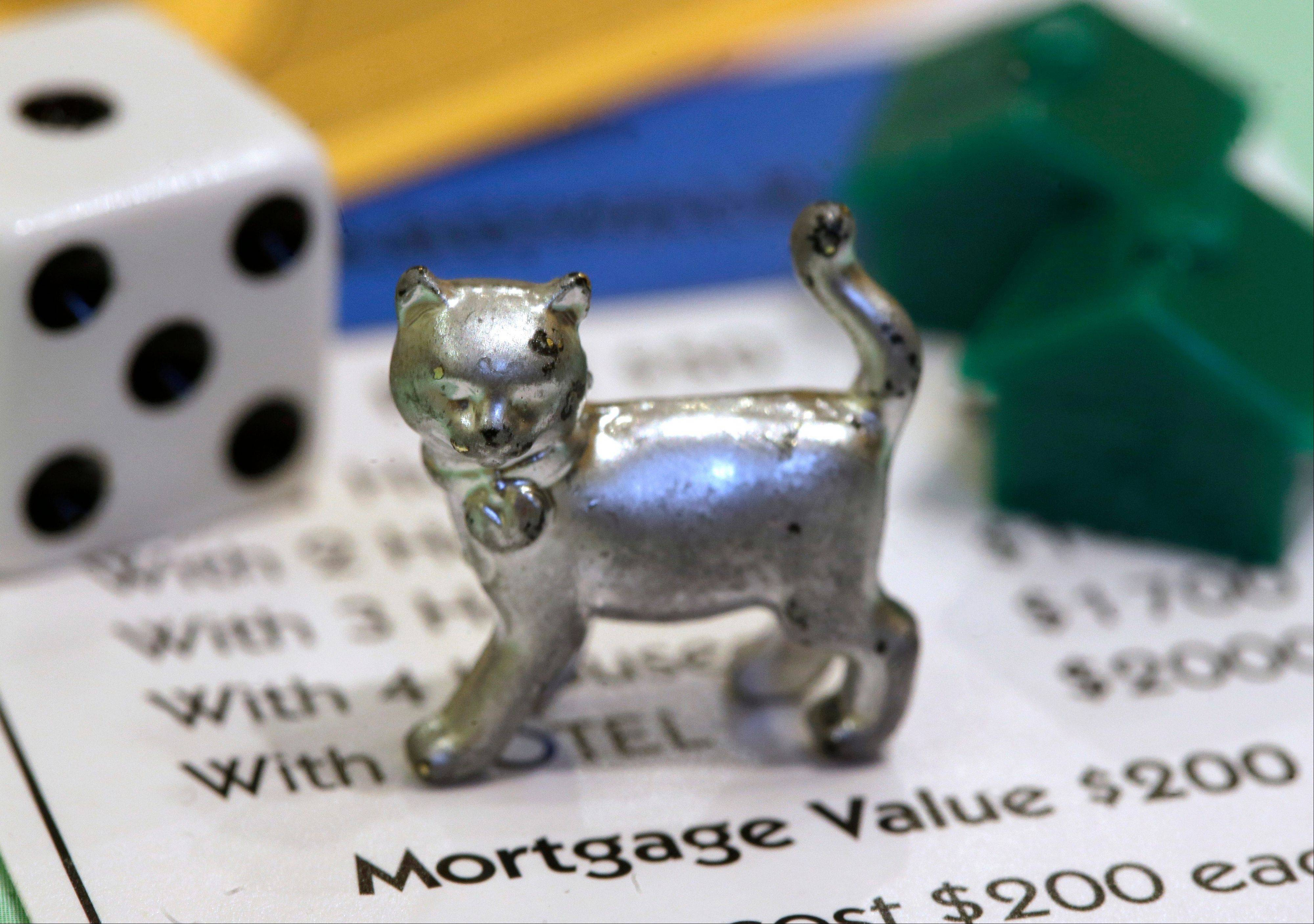 The newest Monopoly token, a cat, will be passing Go soon. Voting on Facebook determined that the cat would replace the iron token.