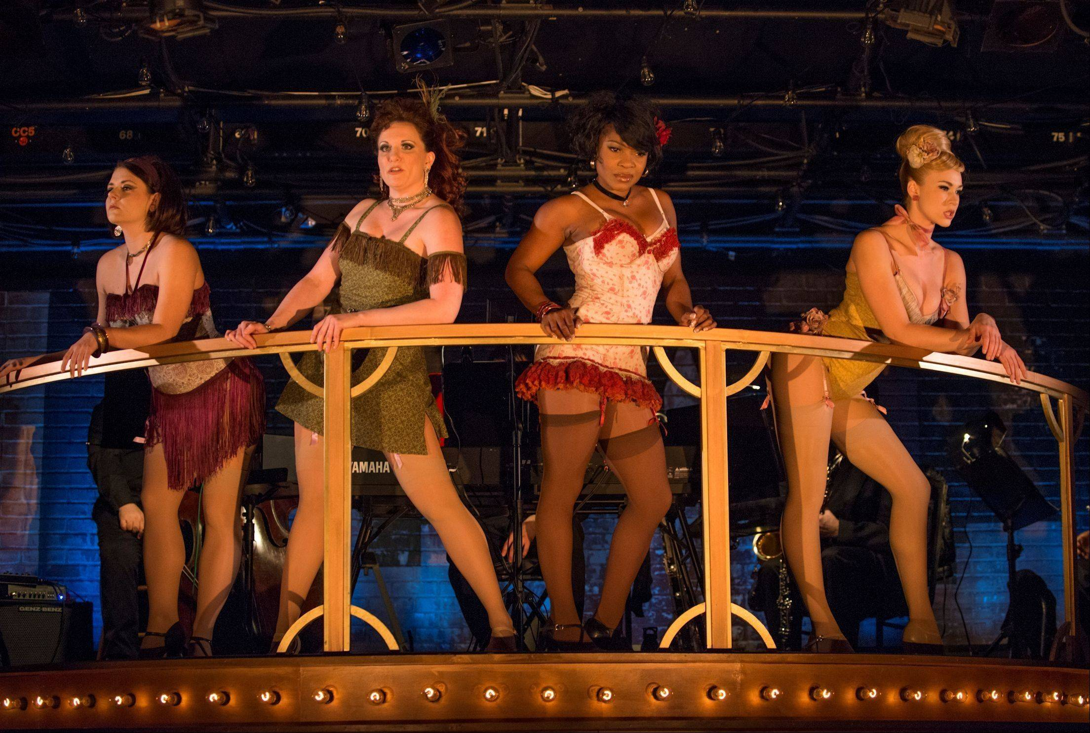 "The girls of the Fandango Ballroom entice customers with a stripped-down ""Big Spender"" in the Writers' Theatre revival of ""Sweet Charity,"" directed by Michael Halberstam, with music direction by Doug Peck."