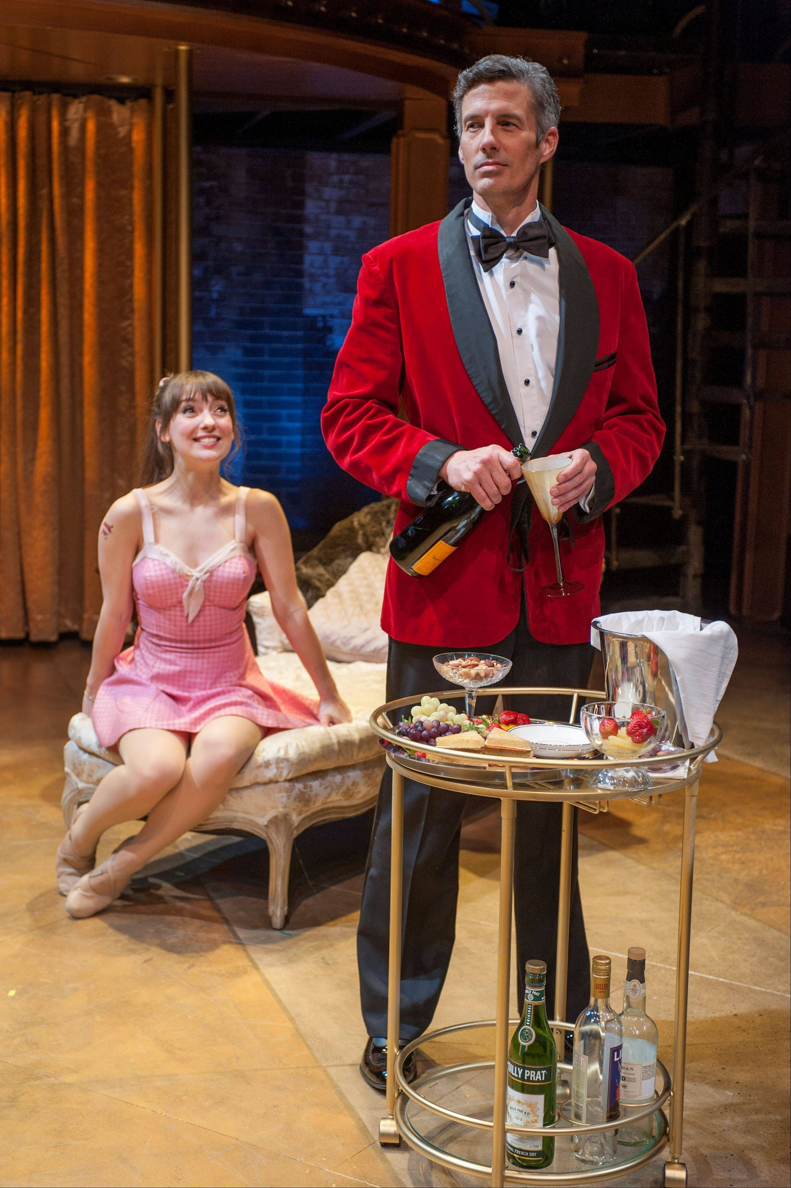 "After stumbling into Italian film star Vittorio Vidal (Jeff Parker), Charity (Tiffany Topol) spends an evening nightclubbing and sipping champagne in the actor's suite in ""Sweet Charity,"" running through March 31 at Writers' Theatre."