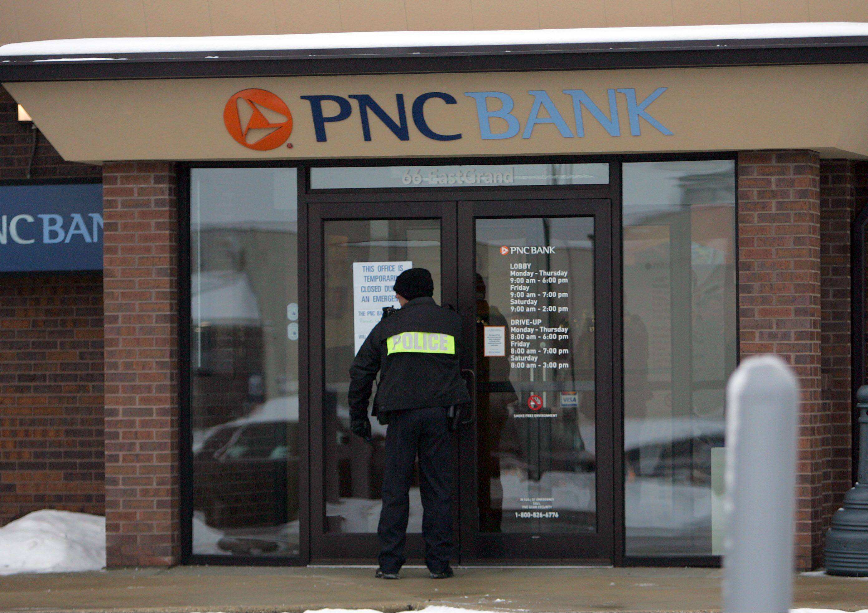 Fox Lake police Lt. Joe Gliniewicz investigates a robbery Tuesday at PNC Bank at 66 E. Grand Ave.