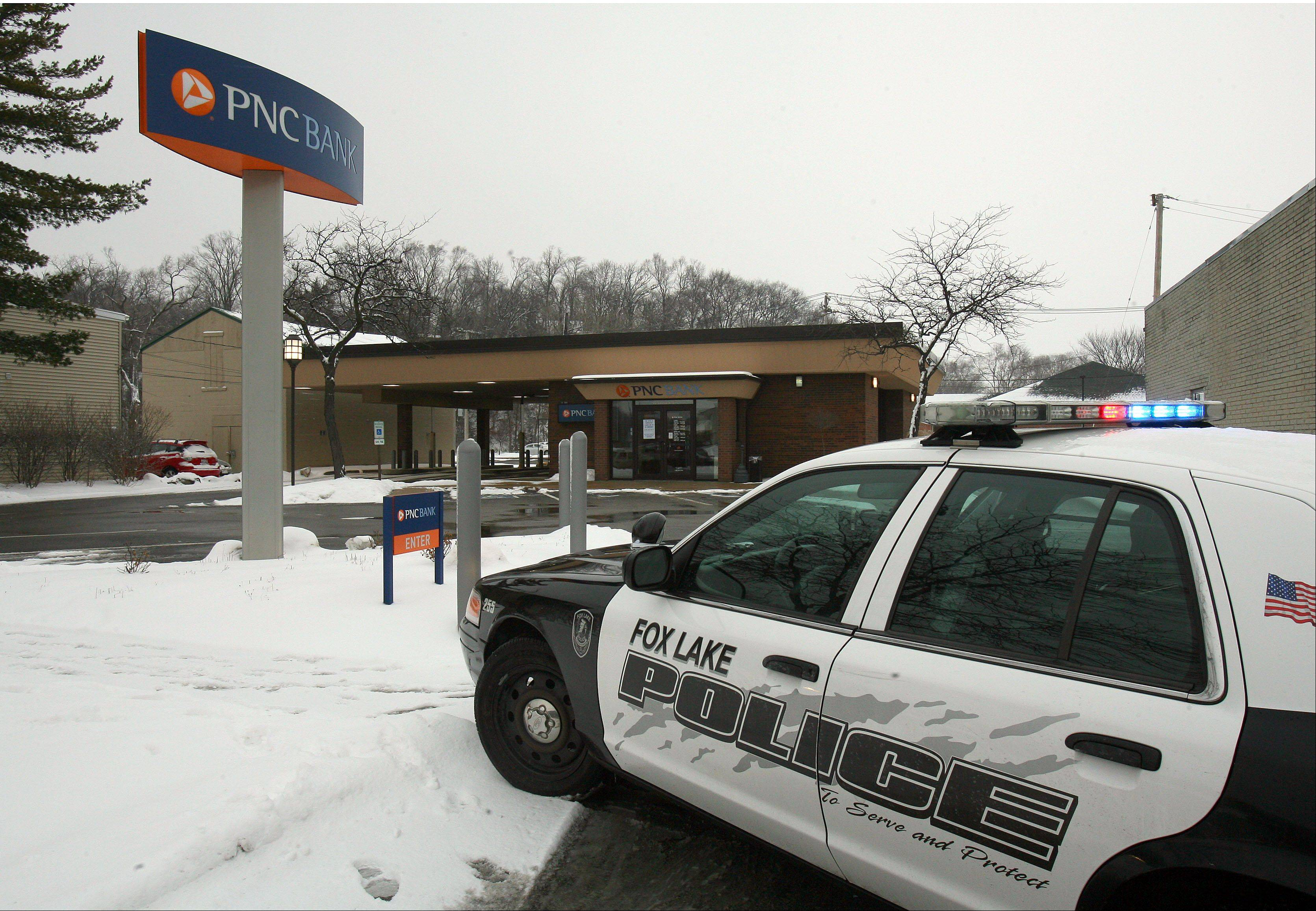 Fox Lake police investigate a robbery at PNC Bank at 66 E. Grand Ave. on Tuesday. The FBI also is probing.