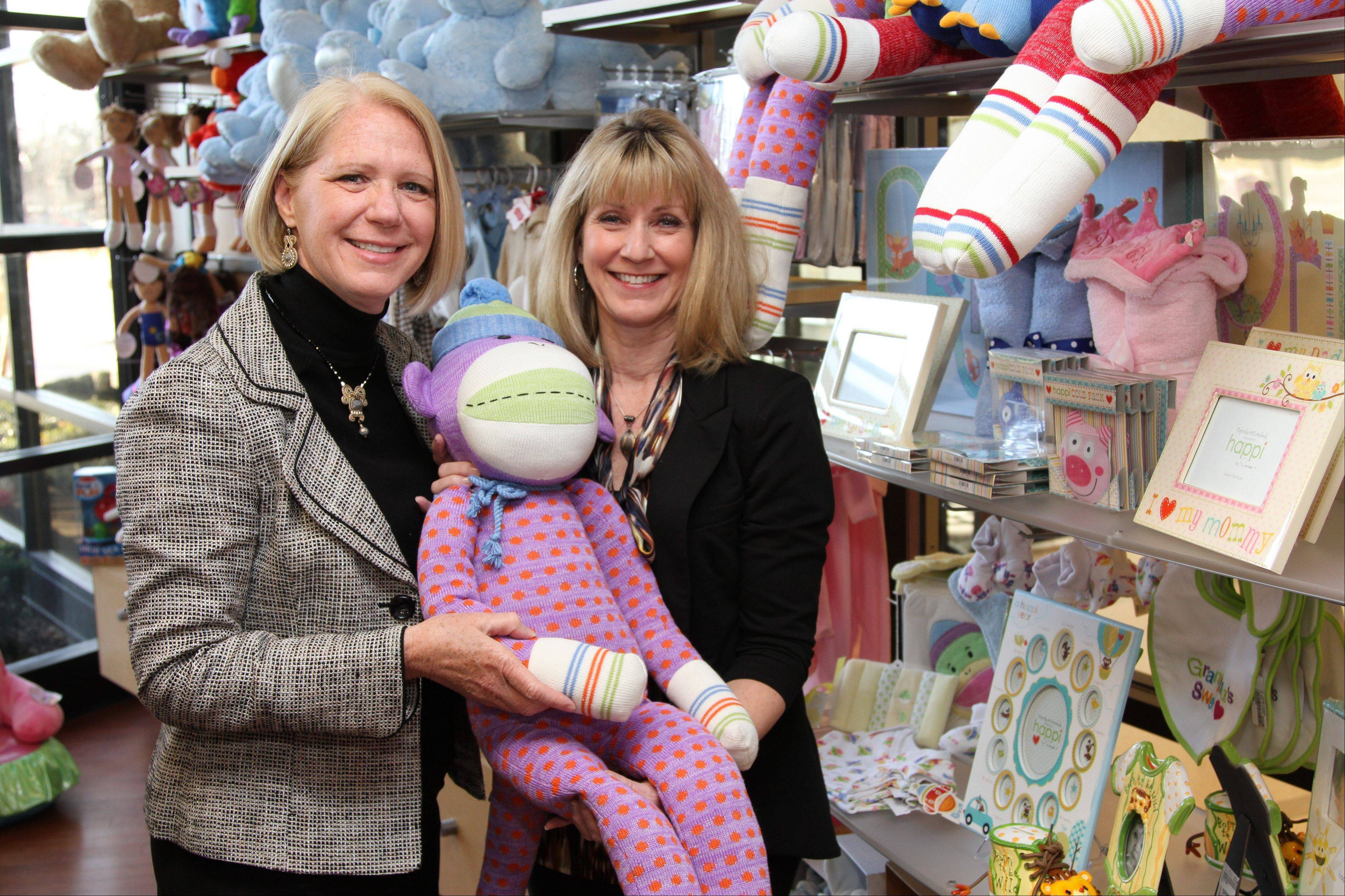 Alexian Brothers foundation members Suzanne Frey and Janice Selden are with gifts coming in for the baby shower for the new Alexian Brothers Women and Children's Hospital in Hoffman Estates.