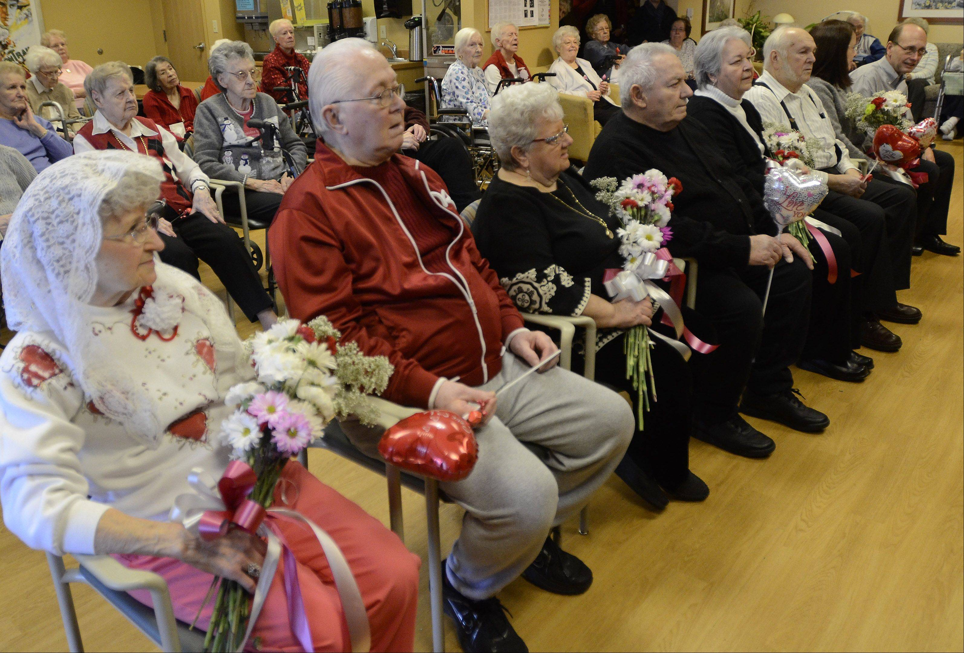 From left, Helen and Arthur Polich, Sue and Bob Richardi, Gayle and David Voyles and Linda and Frank Broz, celebrated Valentine's Day by renewing their wedding vows Thursday at Victory Centre of Bartlett.