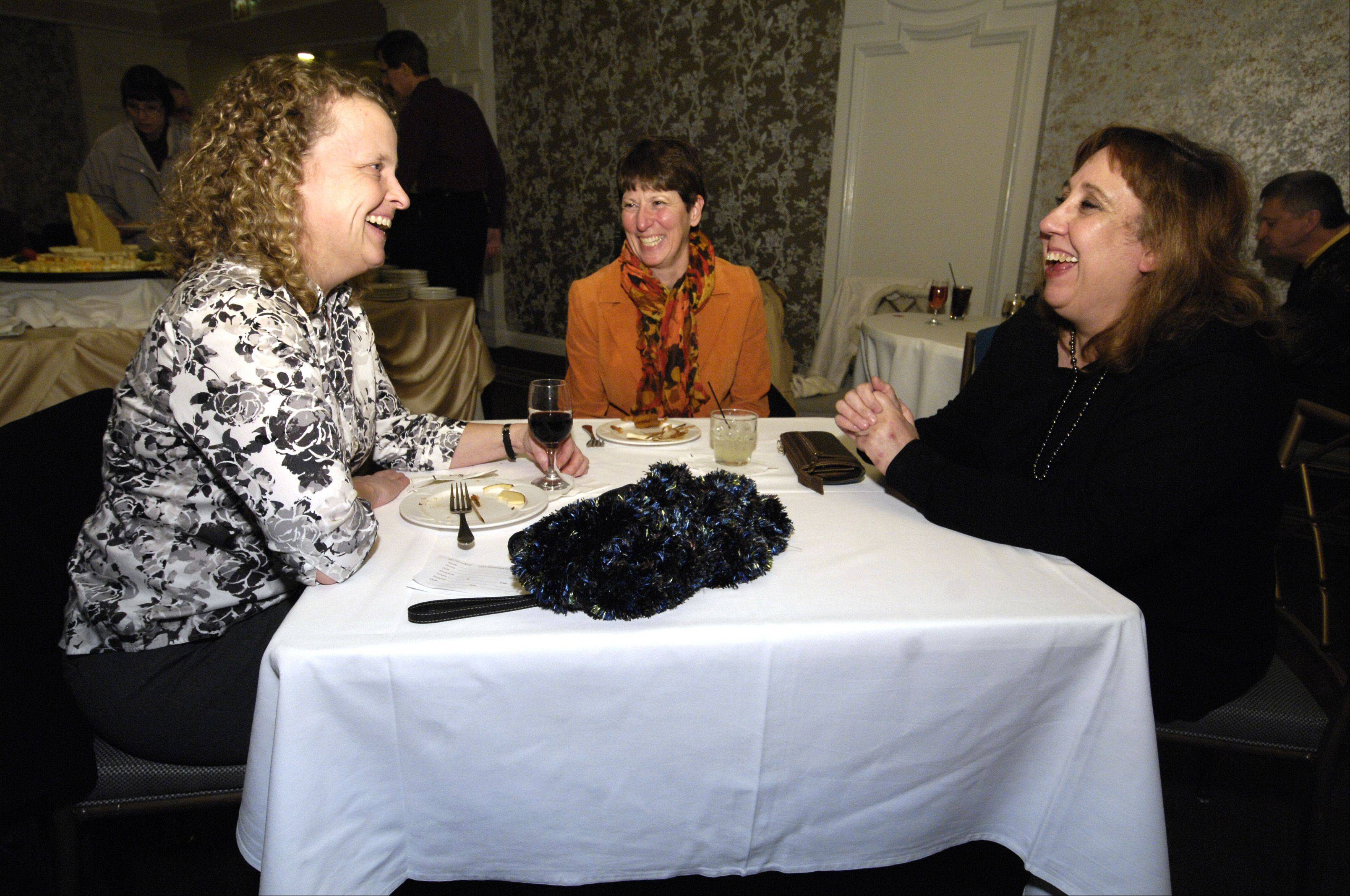 "Patti Scheuman of Wheaton and Juliann DeAngelis of Glen Ellyn chat with Daily Herald theater critic Barbara Vitello during a Subscribers Total Access event before a performance of ""Sunset Boulevard"" Thursday night at Drury Lane in Oakbrook Terrace."