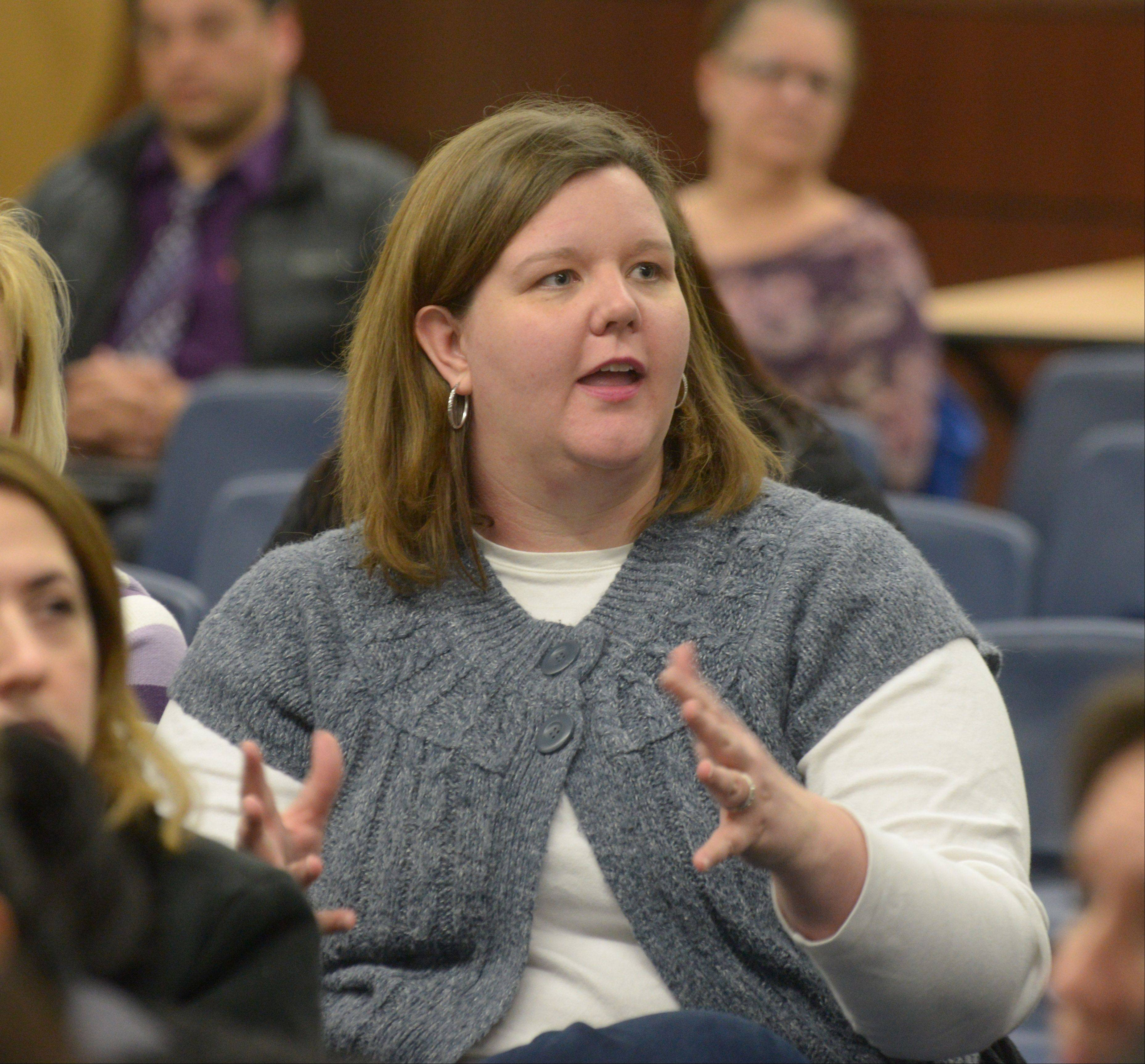 Julie Braun of Winfield asks why it took a strike for West Chicago District 33 and its teachers union to agree on a contract. Braun was one of about 60 parents at a special board meeting Thursday night to discuss a tentative agreement reached that morning.