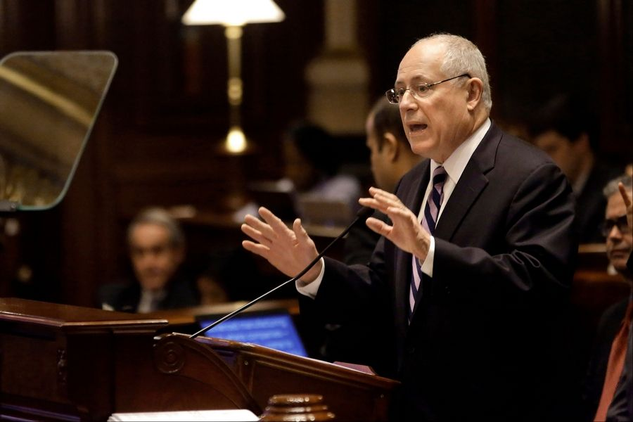 Gov. Pat Quinn delivers his State of the State address to lawmakers. He called for an increase in the minimum wage to $10 per hour as well as new gun control measures.
