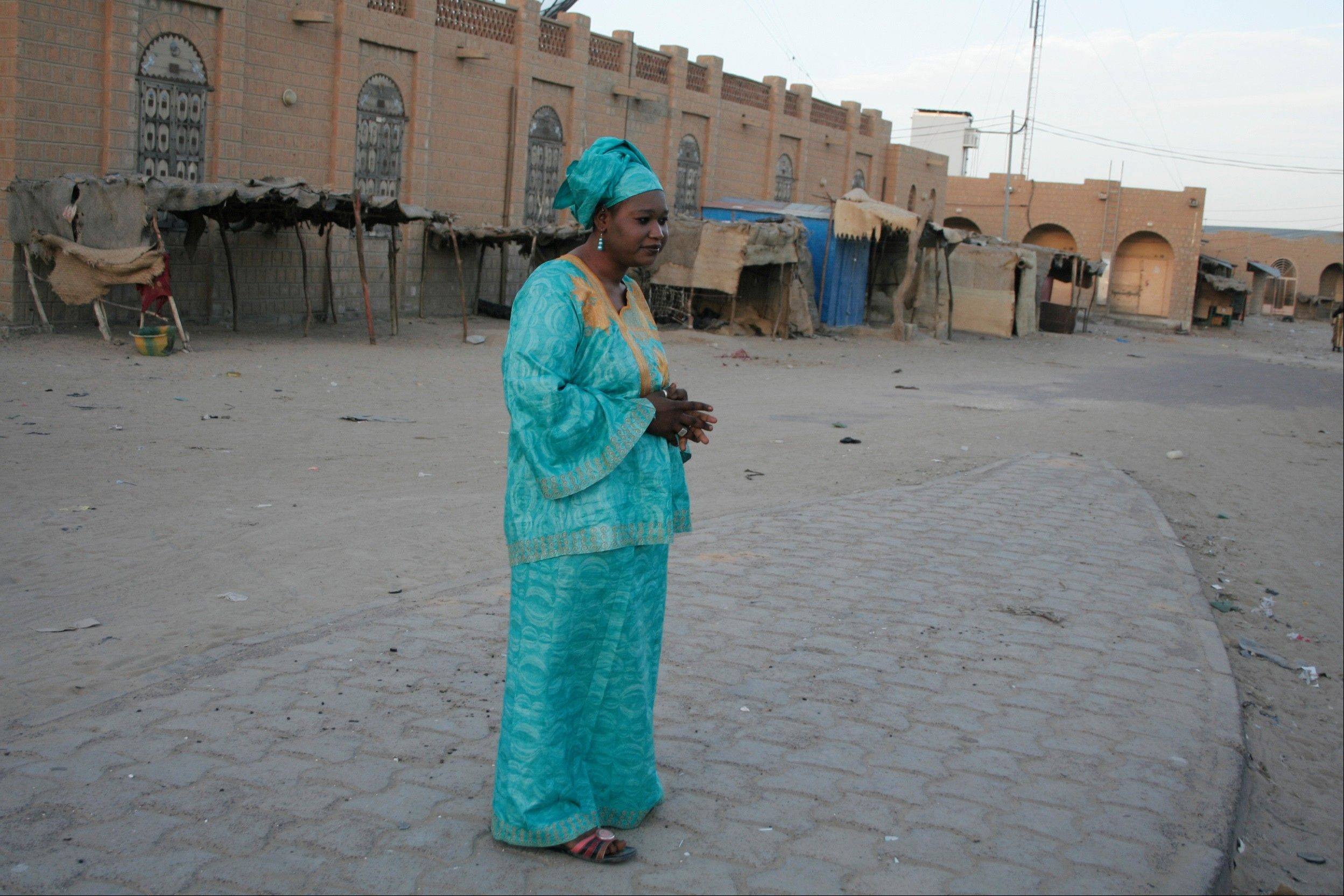 Salaka Djicke stands in the town square where she was publicly whipped after being caught having a relationship with a married man, in Timbuktu, Mali. Until they were chased out by the French last week, the Islamic extremists who controlled northern Mali since April applied a harsh brand of Shariah in the moderate Muslim region. Djicke was jailed and publicly flogged, and at least one other unmarried couple was executed by stoning.