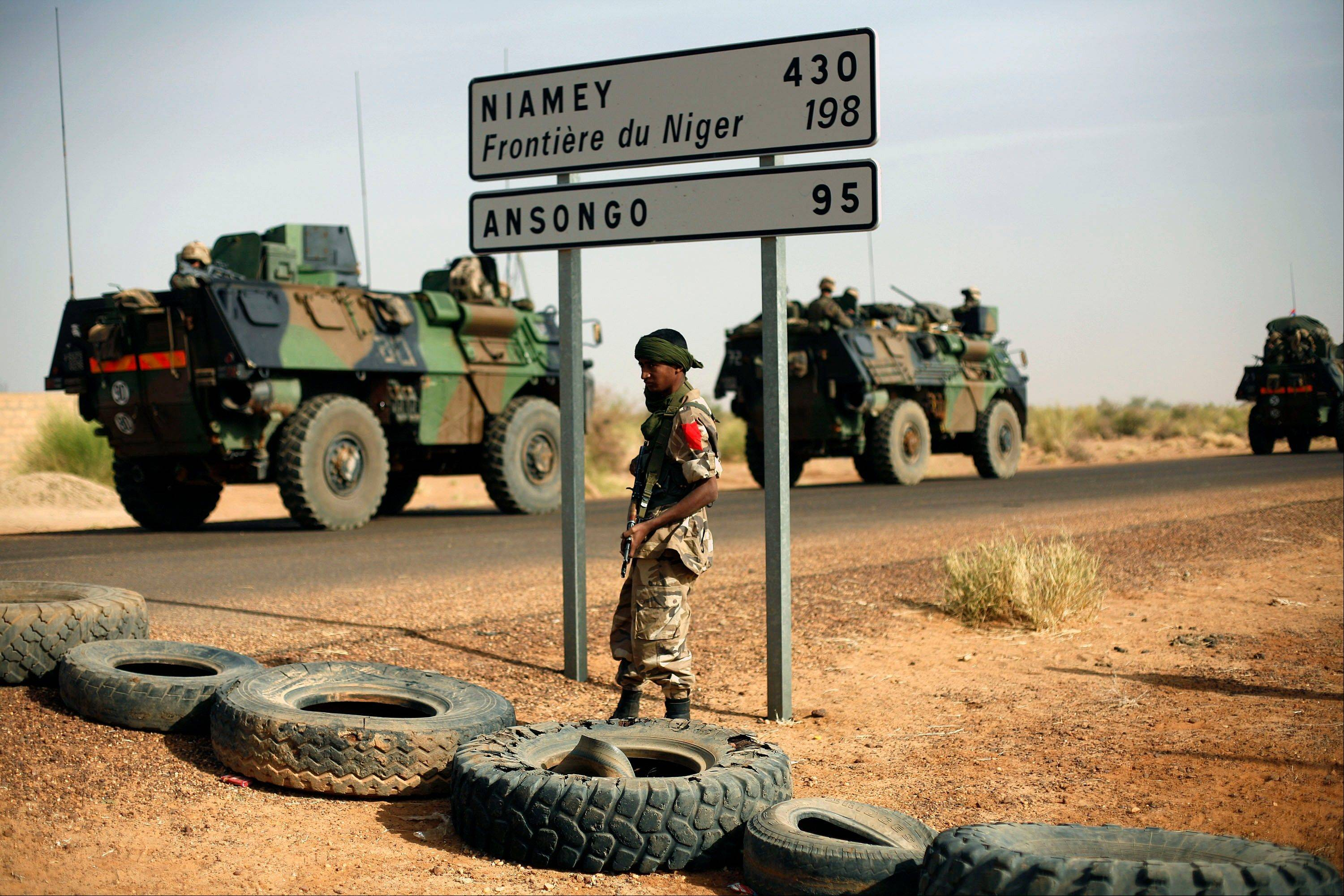 French armored vehicles are seen heading toward the Niger border before making a left turn north in Gao, northern Mali, Wednesday Feb. 6, 2013.