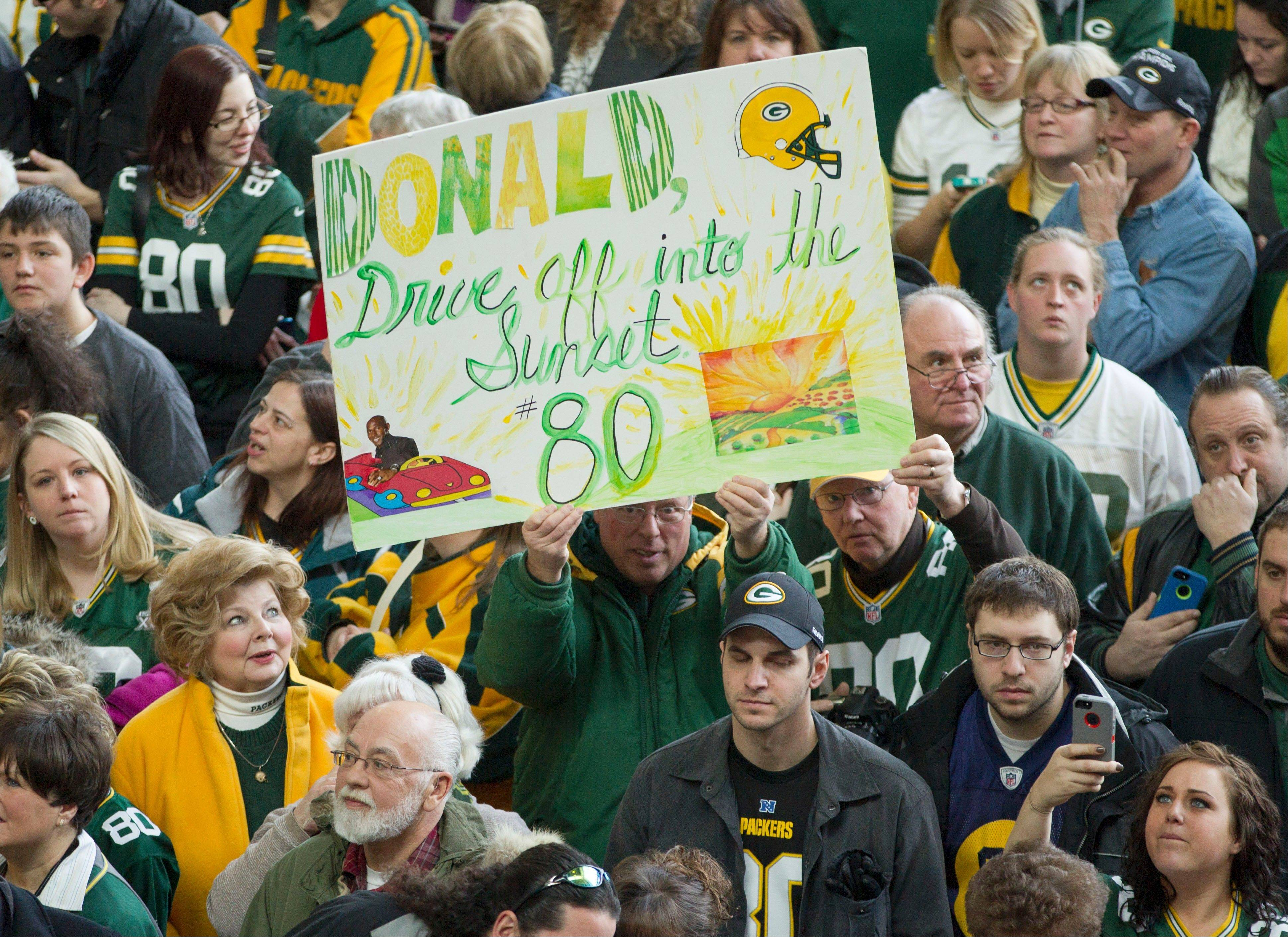 Fans hold up a sign in support for Green Packers all time leading receiver, Donald Driver, during his retirement ceremony Wednesday, Feb. 6, 2013 at Lambeau Field in Green Bay, Wis.