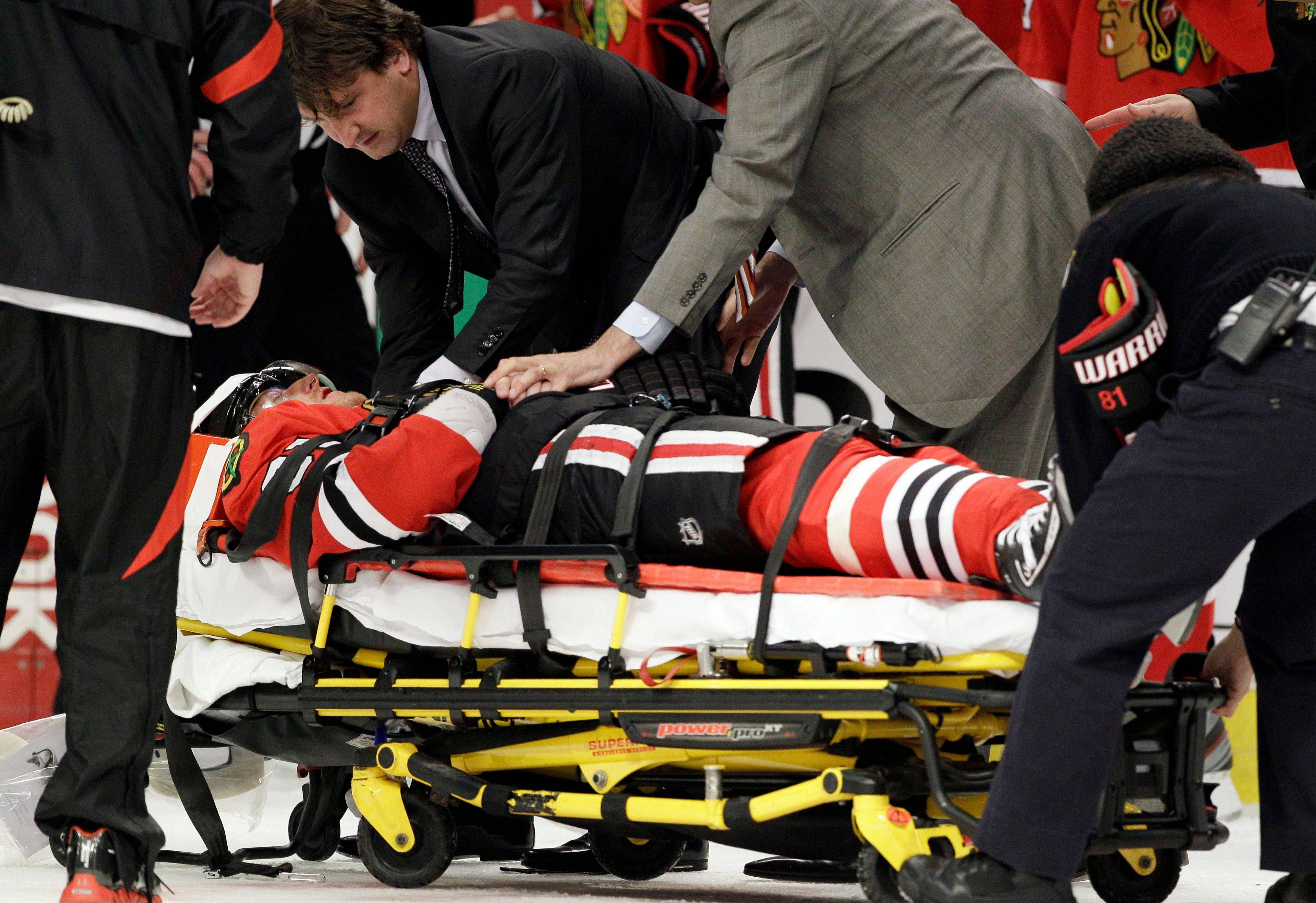 The Hawks' Marian Hossa is taken off the ice on a stretcher after the hit by the Coyotes' Raffi Torres.