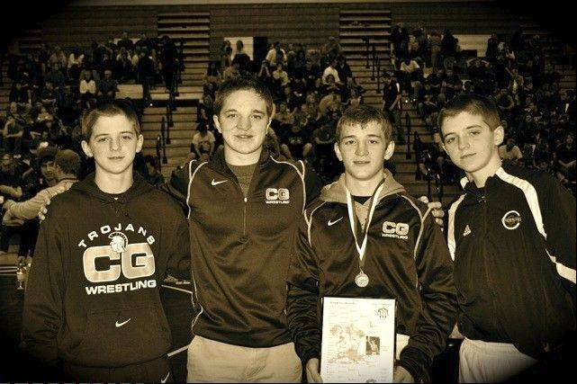 Wrestling is an all-in-the-family affair for the Cullens from Cary-Grove. Shown here during the Barrington tournament earlier this season are brothers Seam, left to right, Brian, Michael and John Cullen. Michael and John will wrestle this weekend at the Class 3A Barrington sectional.