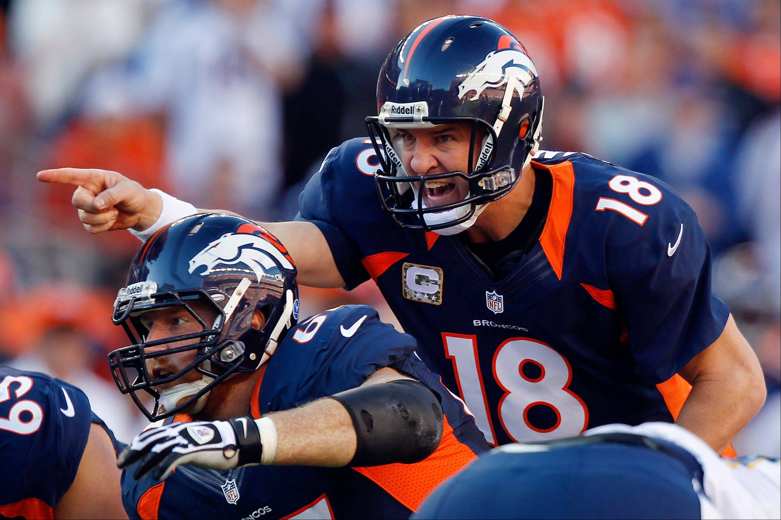 Broncos quarterback Peyton Manning took his new team to the playoffs in his first season in Denver.