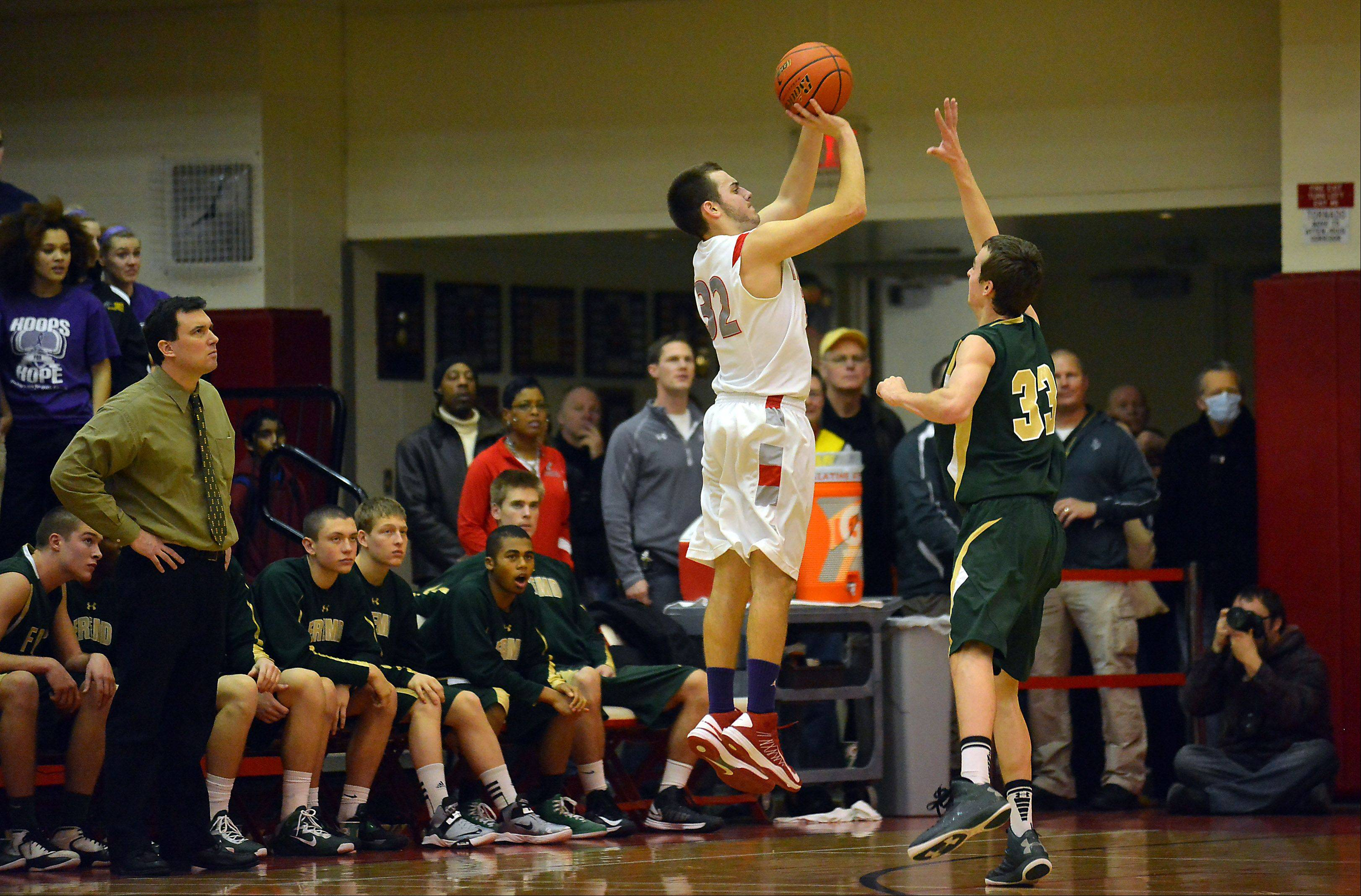 Palatine�s Greg Grana shoots over Fremd�s Sean Benka as he attempts to block the shot last Friday at Palatine. Both teams remain in the MSL West title hunt with two games left.