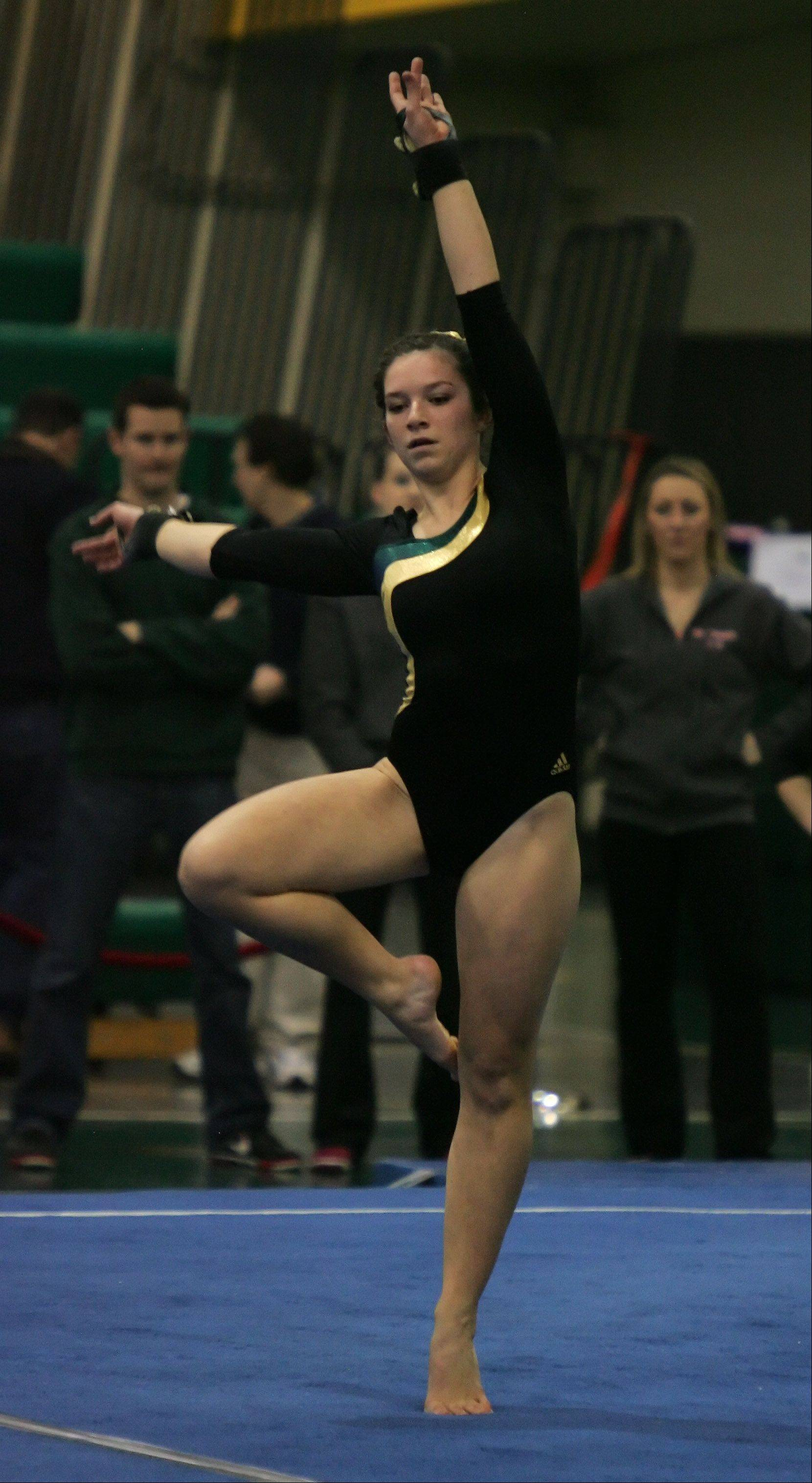 Stevenson�s Riley Trebilco works the floor exercise during the sectional action at Stevenson on Thursday.