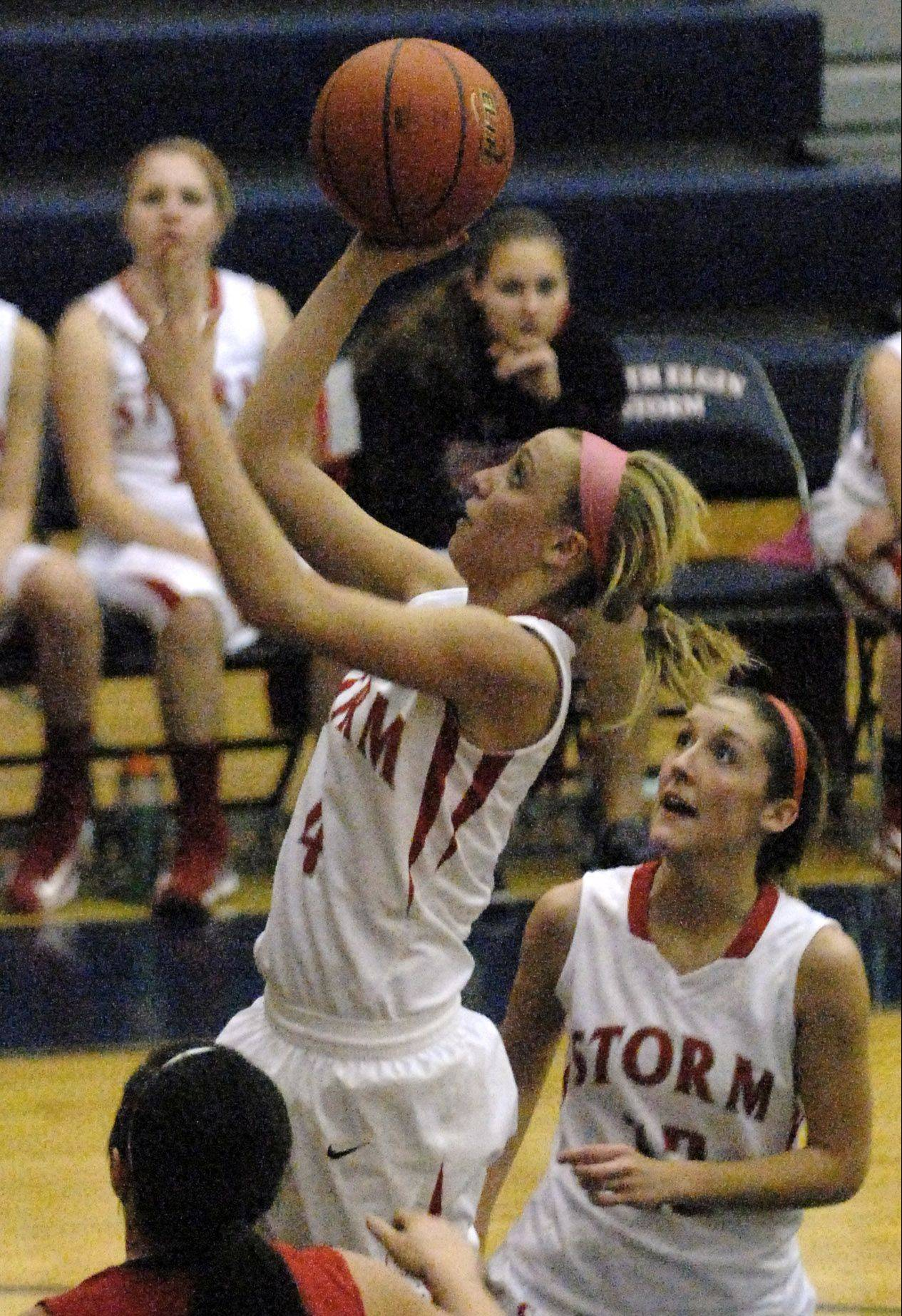 South Elgin�s Savanah Uveges scores on a runner during Thursday�s game against Batavia in South Elgin.