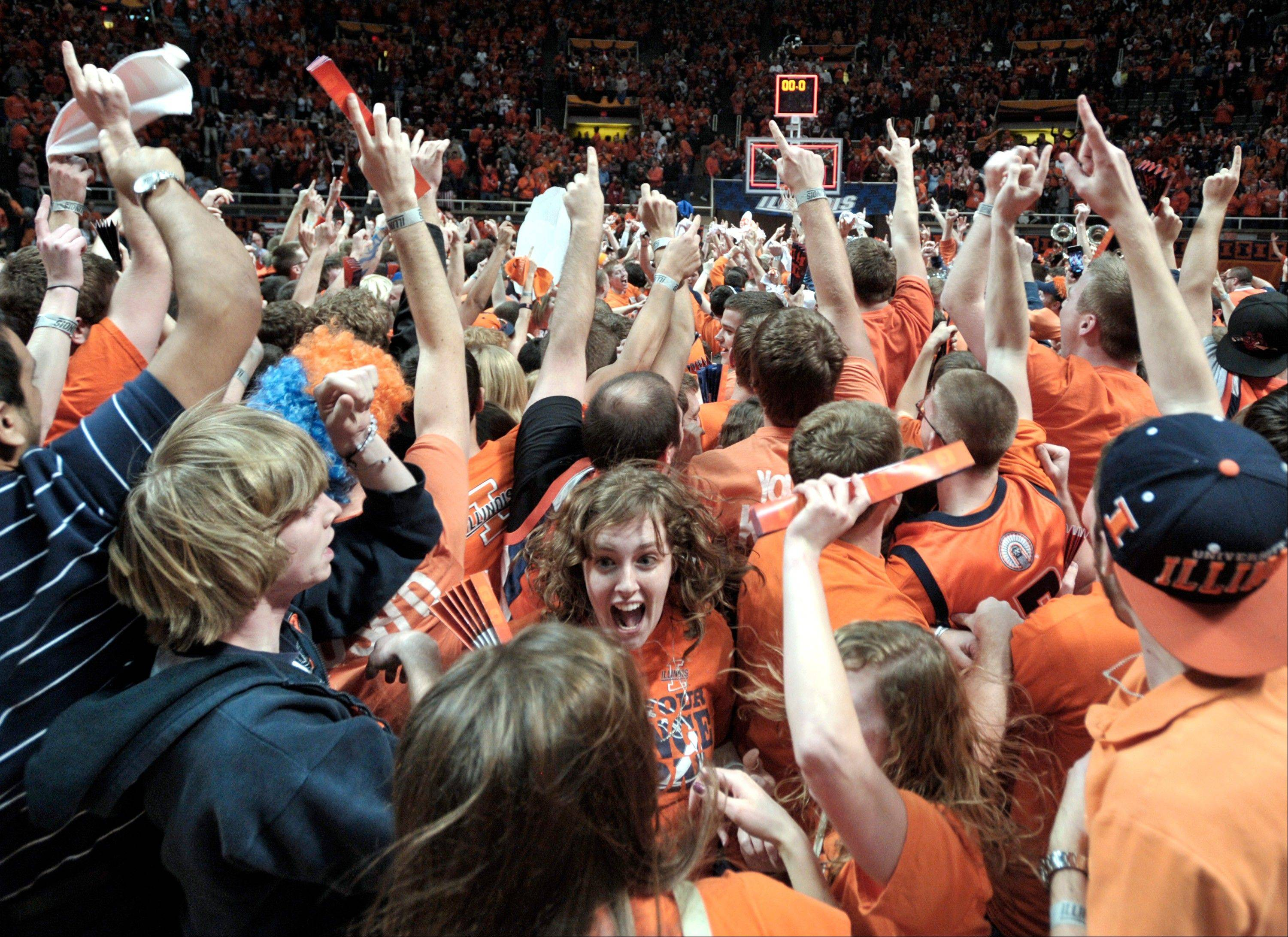 Illinois fans celebrate after the Illini upset No. 1-ranked Indiana 74-72 Thursday at Assembly Hall in Champaign.