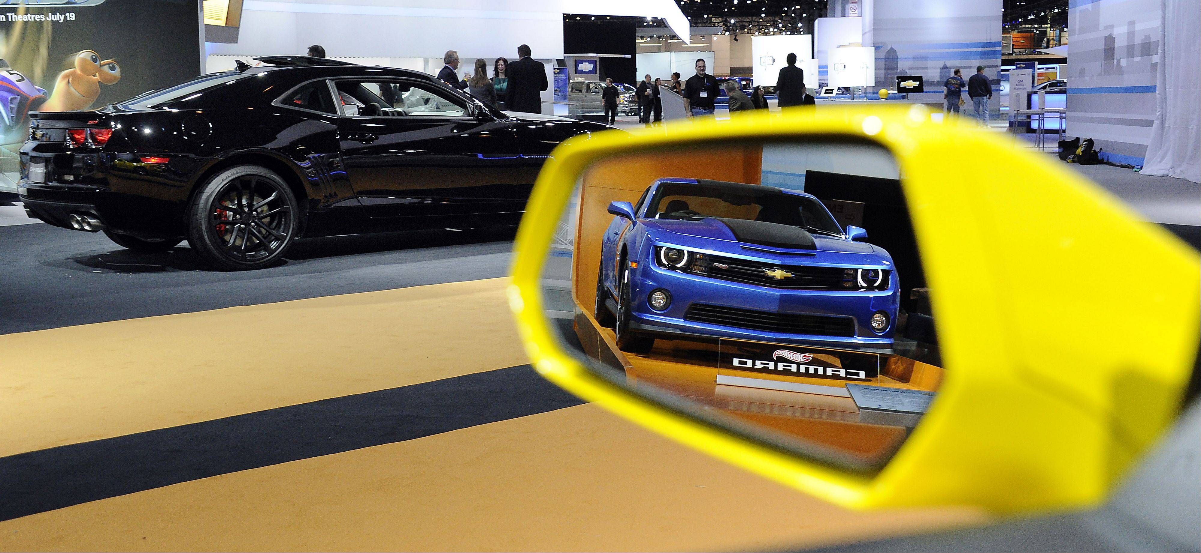 The new Chevrolet Camaro Hot Wheels Edition is reflected in the mirror of another Camaro at the Chicago Auto Show Thursday.