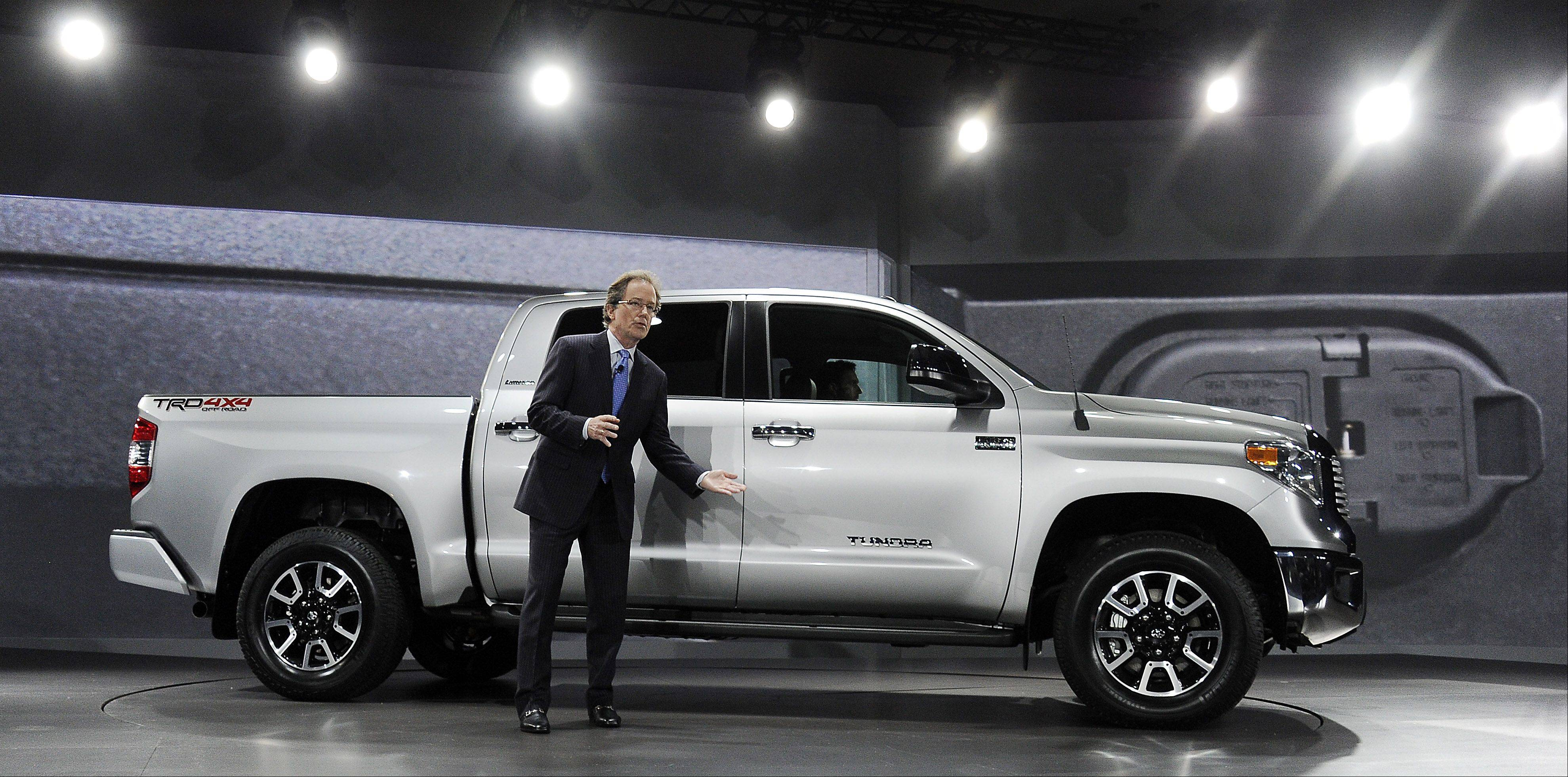 Bill Fay, Toyota group vice president and general manager, shows off the new Tundra four-wheel drive truck at the Chicago Auto Show on Thursday.