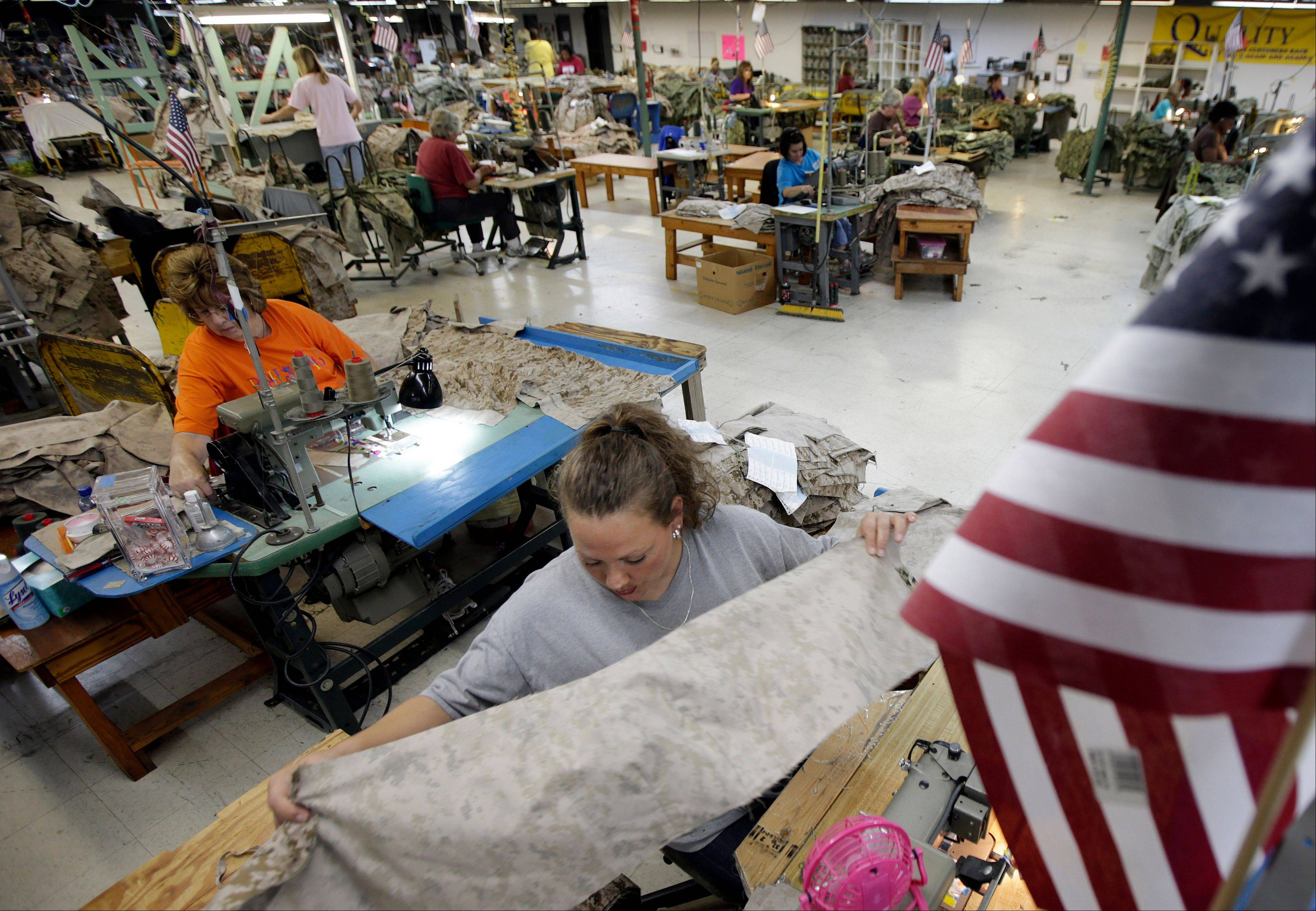 Apparel worker Misti Keeton sews military apparel in Fayette, Ala.