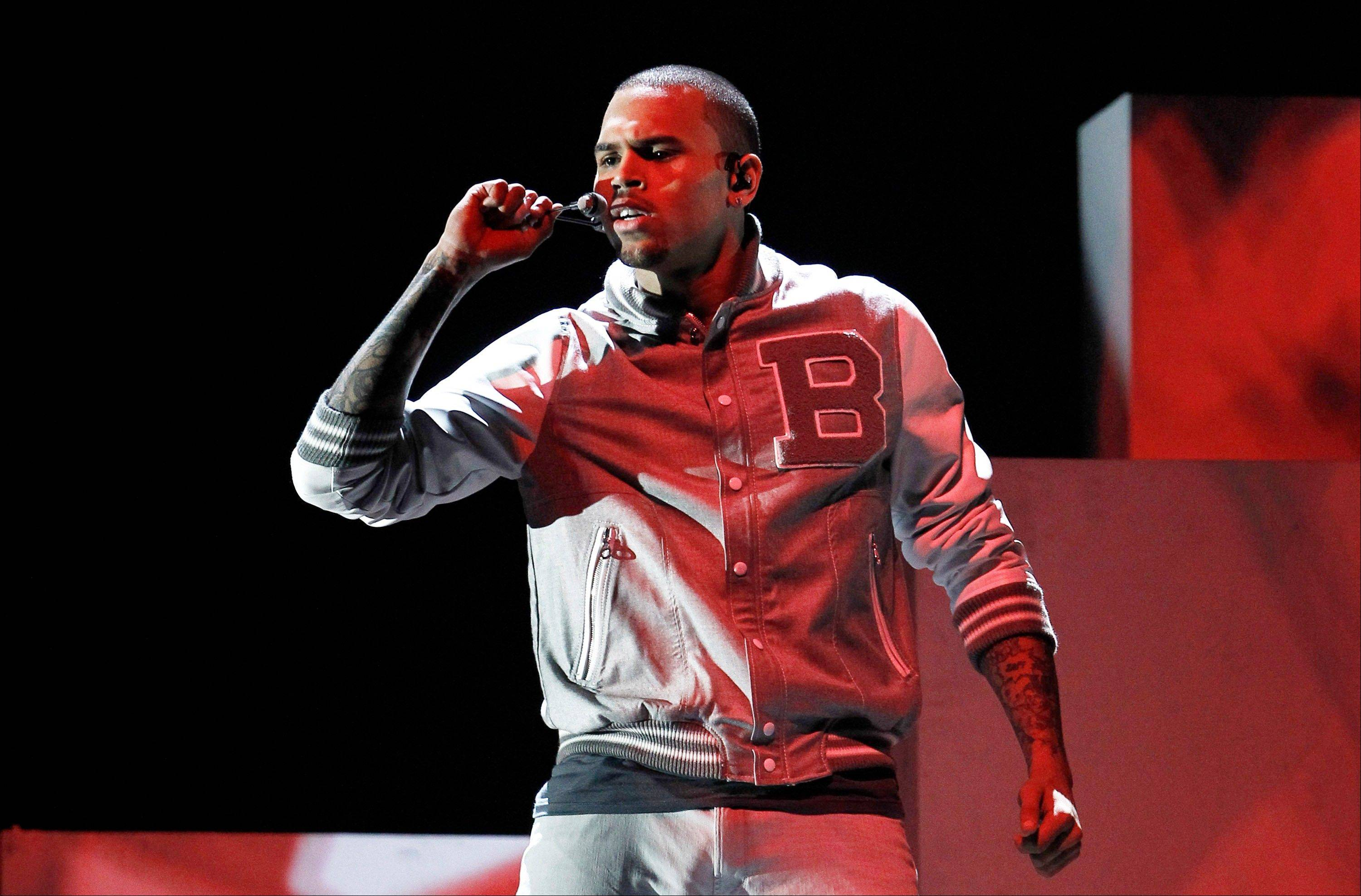 Chris Brown, shown performing during last year's Grammys, returned to a Los Angeles court on Wednesday for a hearing in which prosecutors wanted a judge to revoke his probation and order him to redo his community labor because of concerns about the accuracy of records provided by Virginia authorities. Brown remains on probation for the 2009 beating of Rihanna.