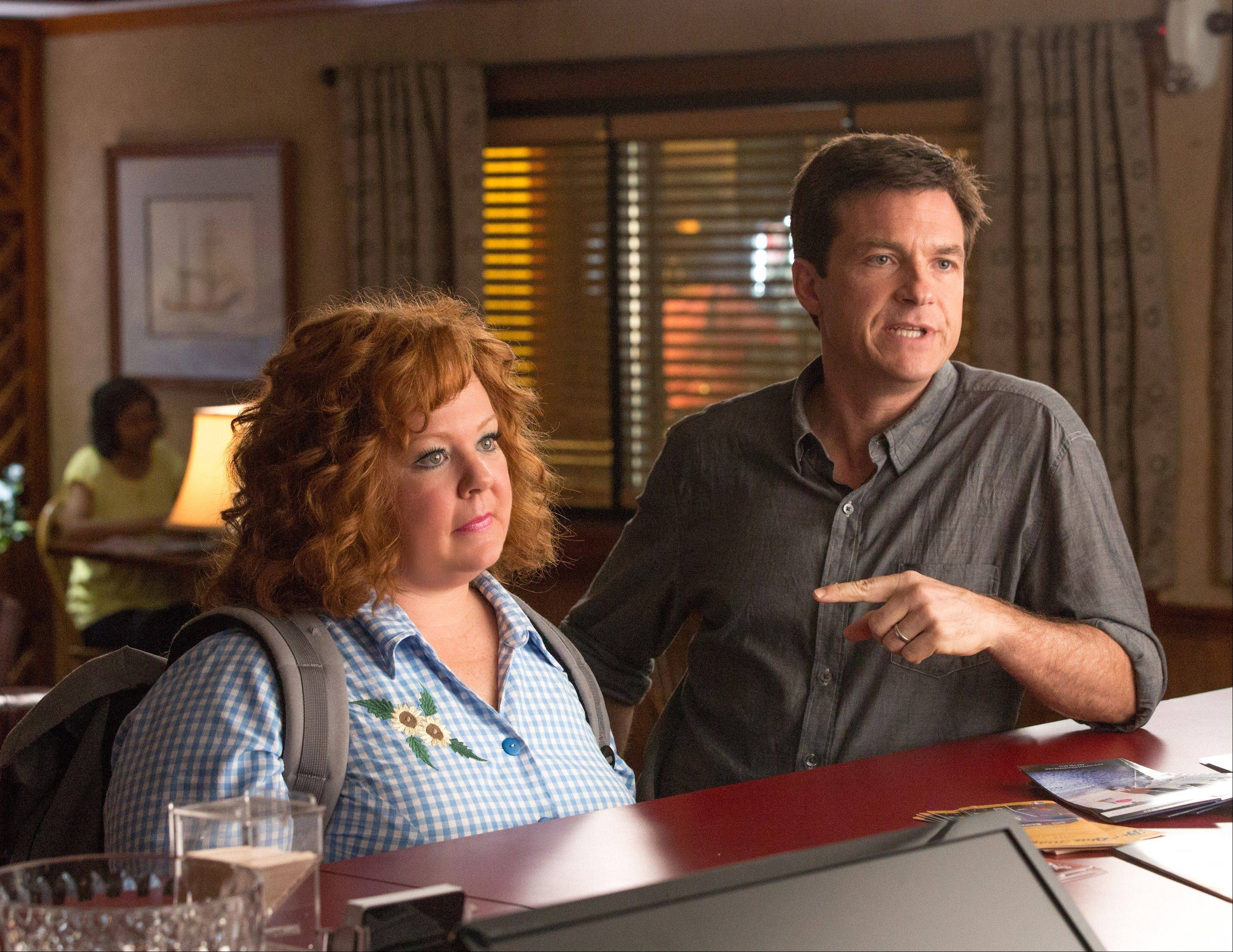 "Jason Bateman tries to bring a con artist played by Melissa McCarthy to justice for stealing his identity and ruining his credit score in ""Identity Thief."""