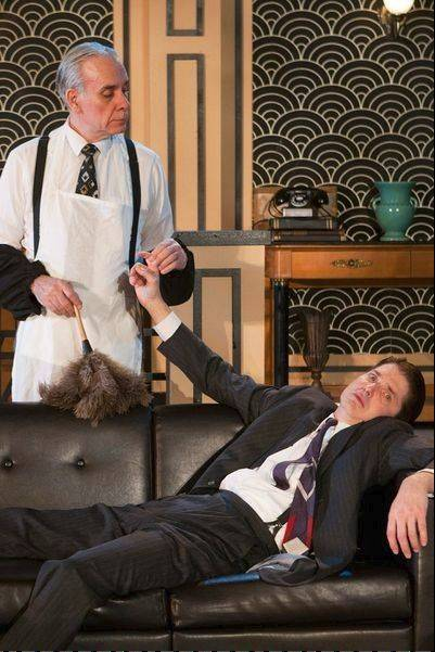 "Jeeves (Jim McCance, left) tidies up the home of his overwhelmed employer Bertie Wooster (Christian Gray) in First Folio Theatre's delightful ""Jeeves Takes a Bow,"" directed by Alison C. Vesely."