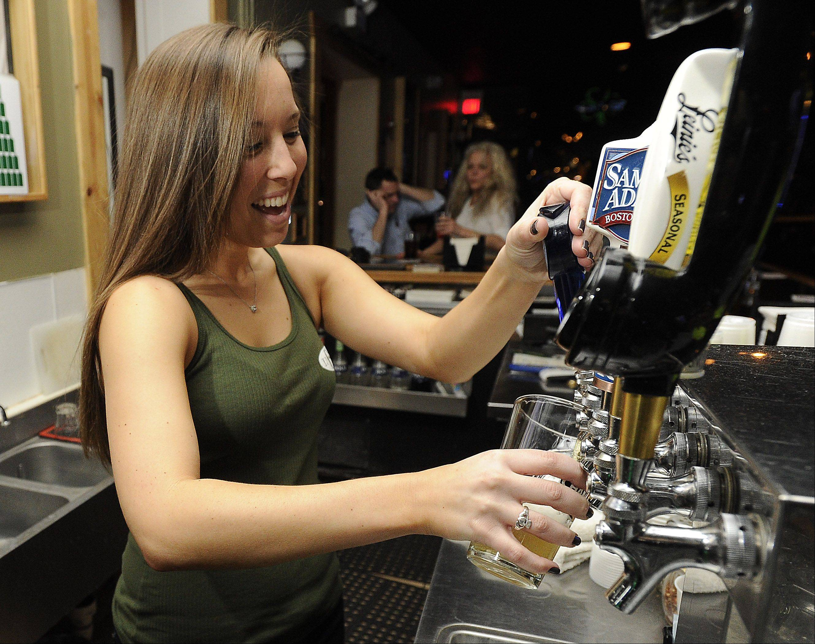 Bartender Megan Shipley will pour you a drink at TJ O'Brien's Bar and Grill in downtown Palatine.