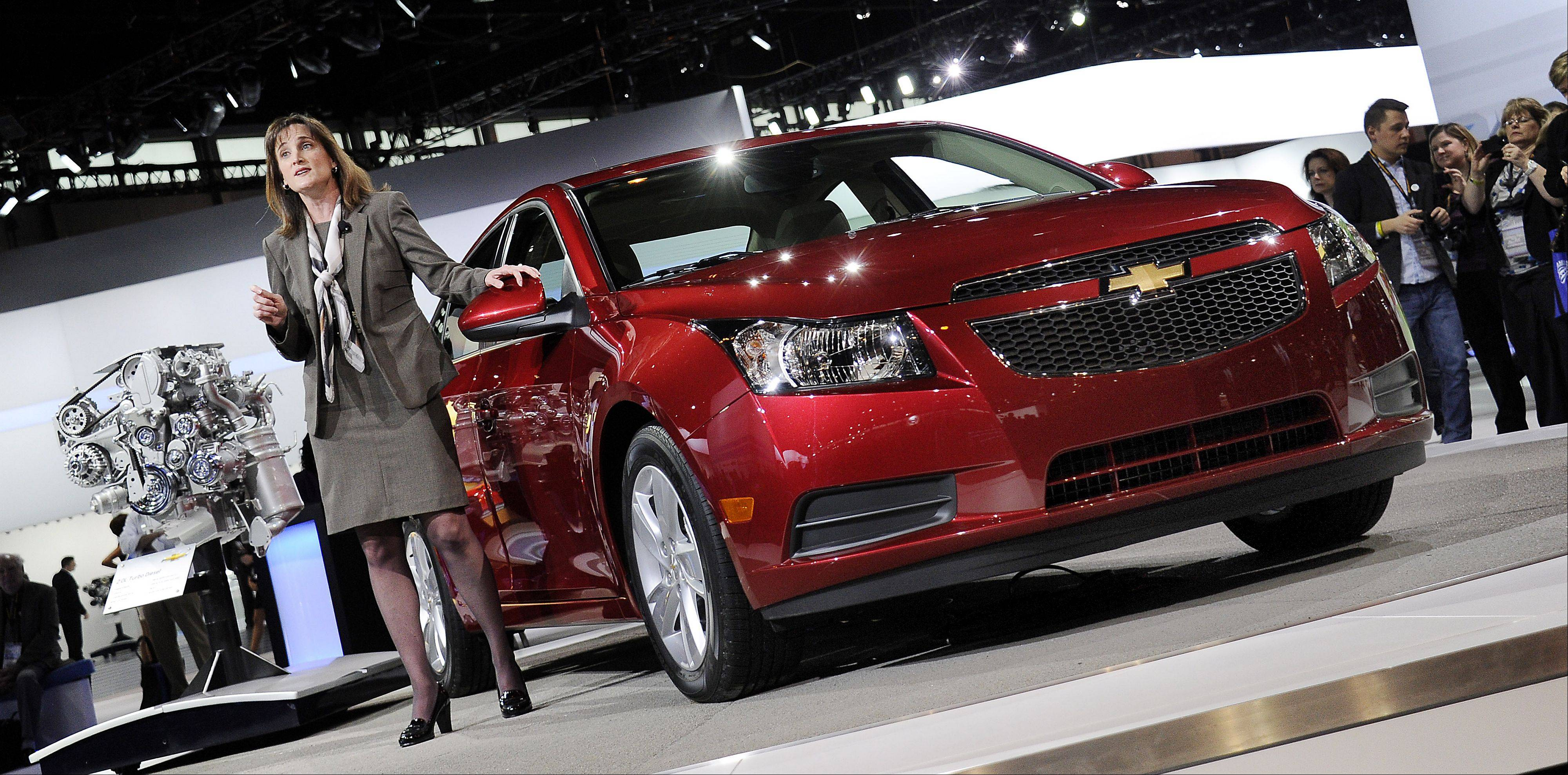 Christi Landy, Marketing Director, Chevrolet Small Cars, show off the 2014 Cruze Clean Turbo Diesel.