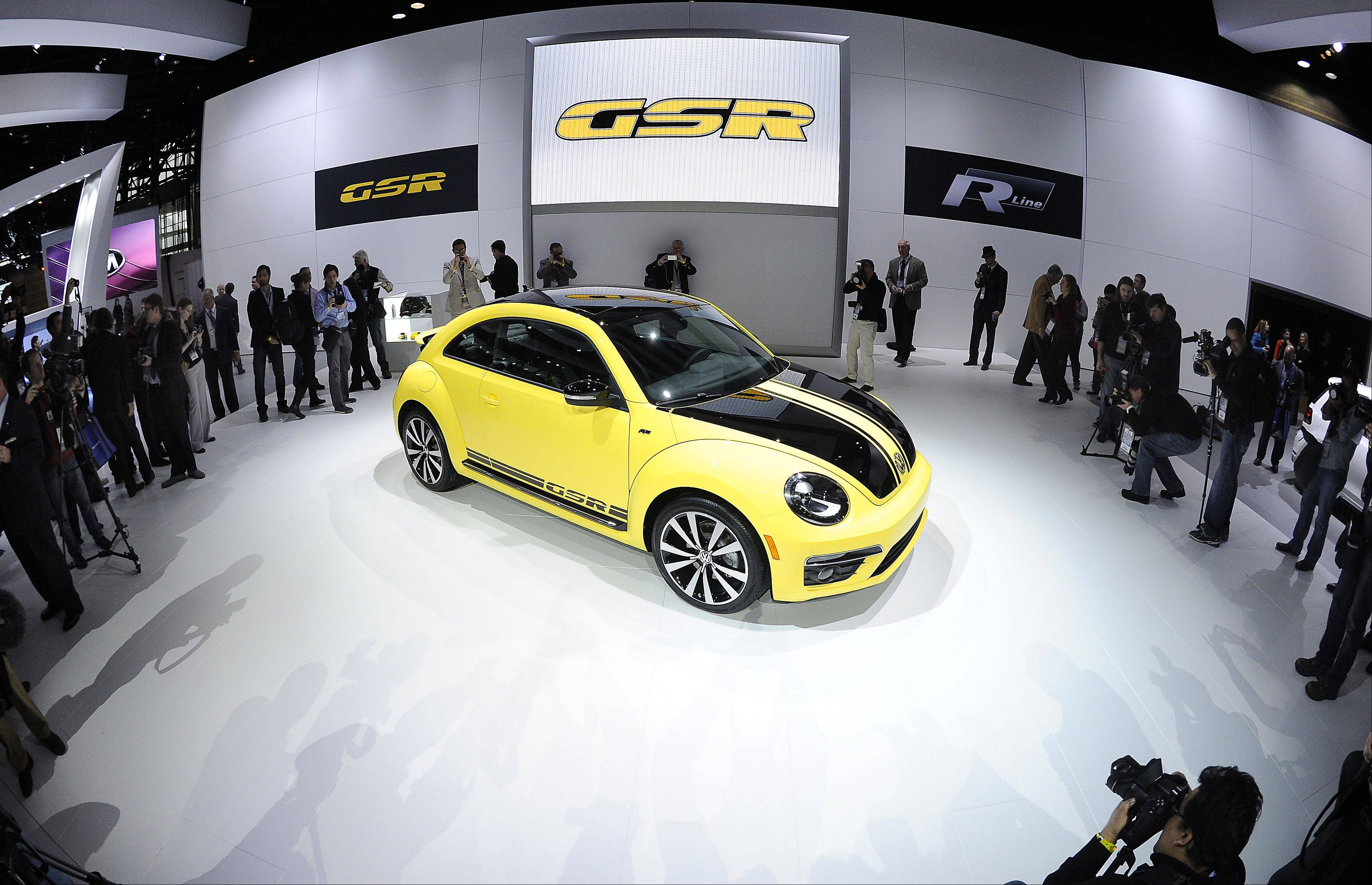 The 2014 GSR yellow and black Volkswagen is unveiled.