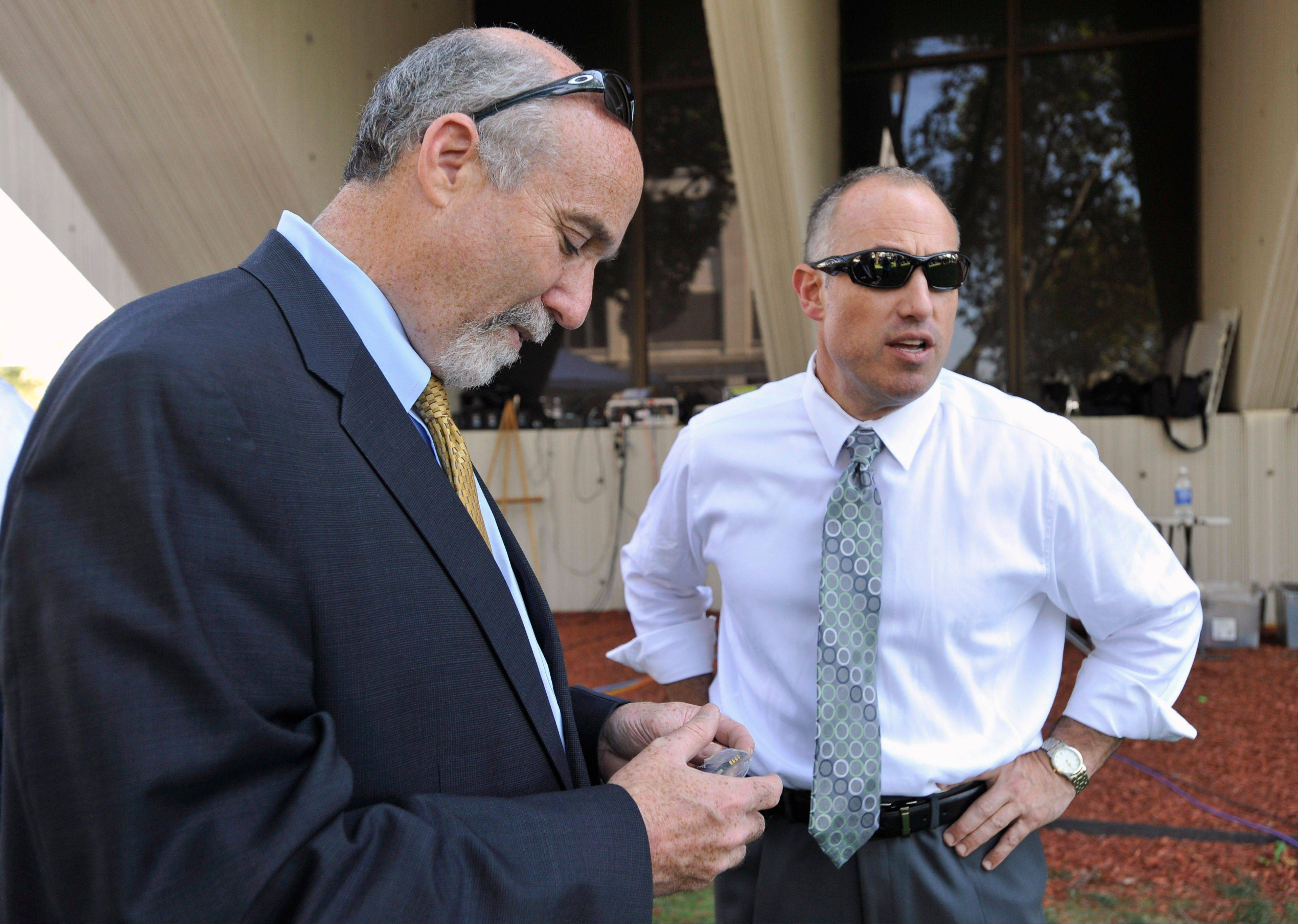 Joel Brodsky, left, and Steven Greenberg, attorneys for former Bolingbrook police sergeant Drew Peterson, confer outside the Will County courthouse in Joliet during the jury deliberations in Peterson's murder trial last September.