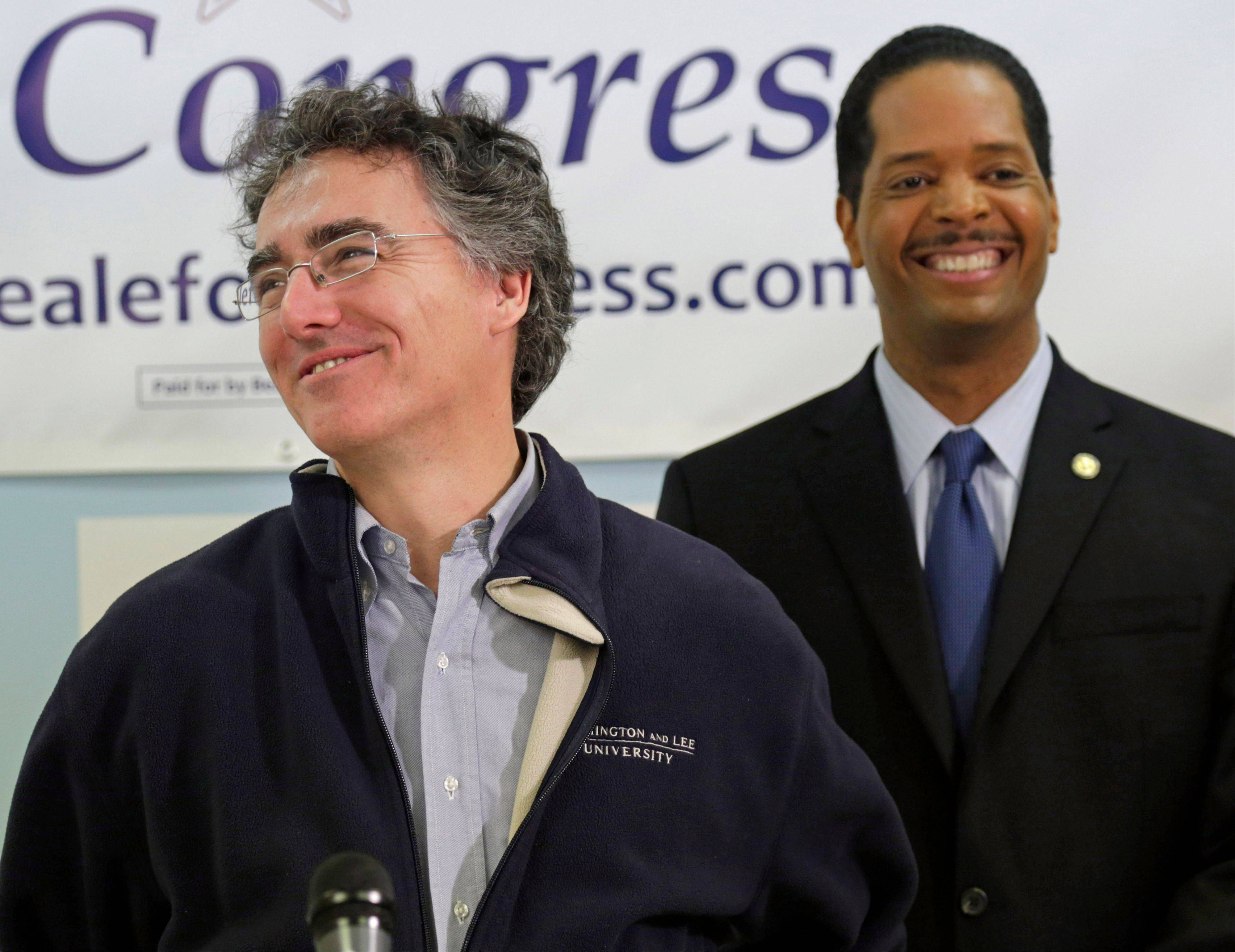 Cook County Sheriff Tom Dart, left, and Democratic congressional hopeful Anthony Beale share a light moment at a news conference Thursday in Chicago. Dart endorses the Chicago alderman in his bid to replace former U.S. Rep. Jesse Jackson Jr. in Illinois' 2nd Congressional District.