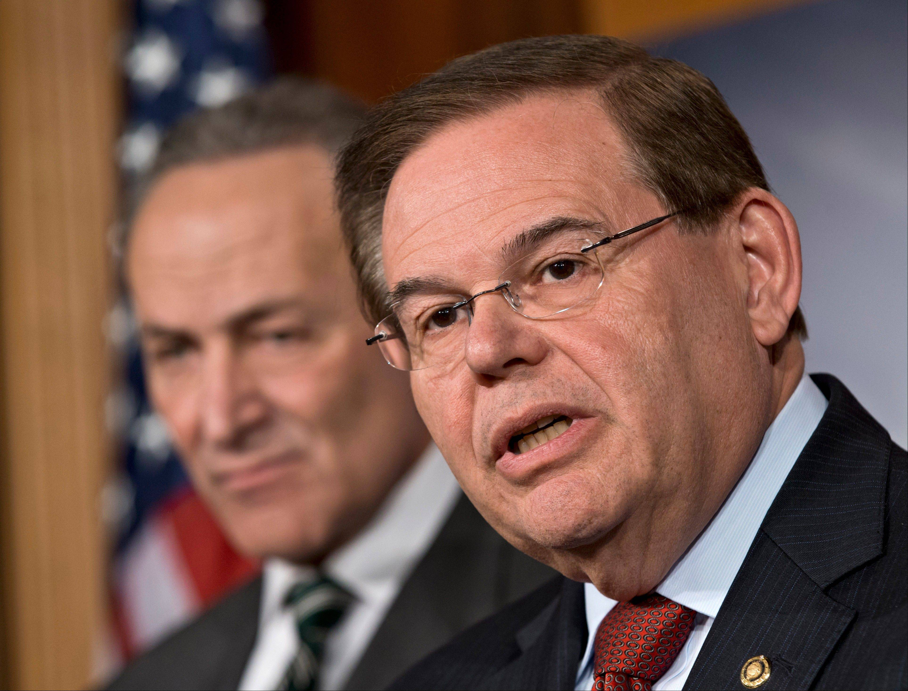 Sen. Robert Menendez, right, acknowledged Wednesday that his office contacted U.S. health agencies in a way that would help the biggest political donor to his re-election, the same eye doctor whose private jet Menendez used for two personal trips to the Dominican Republic.
