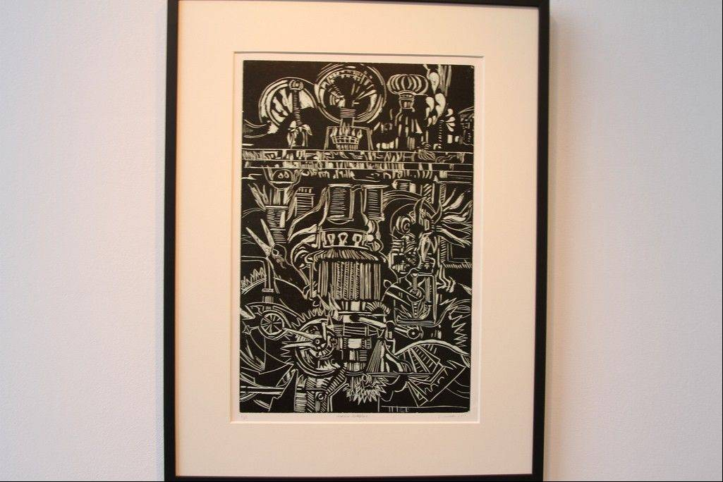 "Bill Wimmer's ""Machine Metaphor"" is a woodcut print that plays with imagery of animation of mechanical motors and parts morphing into more organic and figurative imagery."