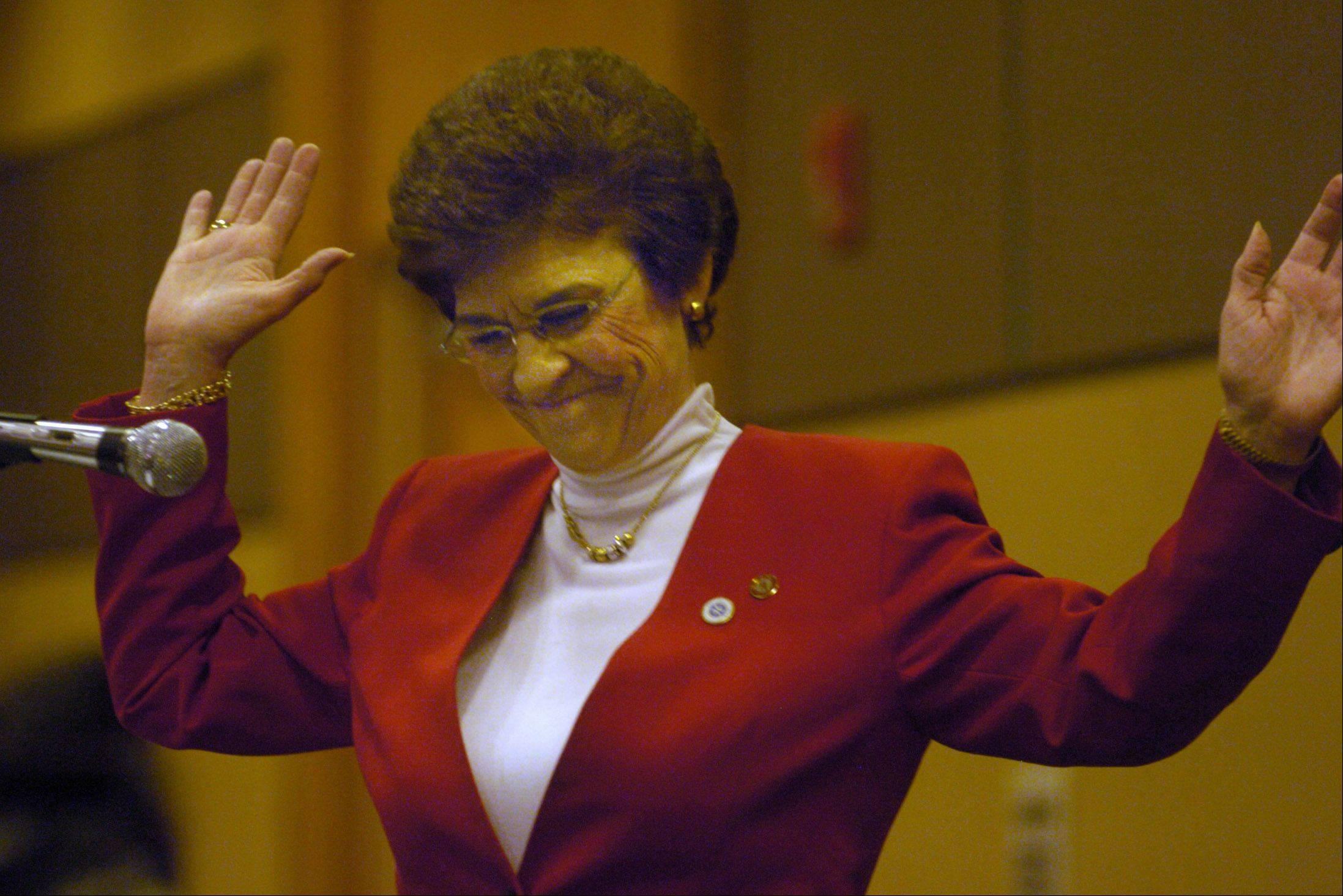 Arlington Heights Mayor Arlene Mulder is applauded Thursday after being introduced at her final Mayor's 26th annual Community Prayer Breakfast. Mulder, who's presided over the event for 20 years, is retiring in April.