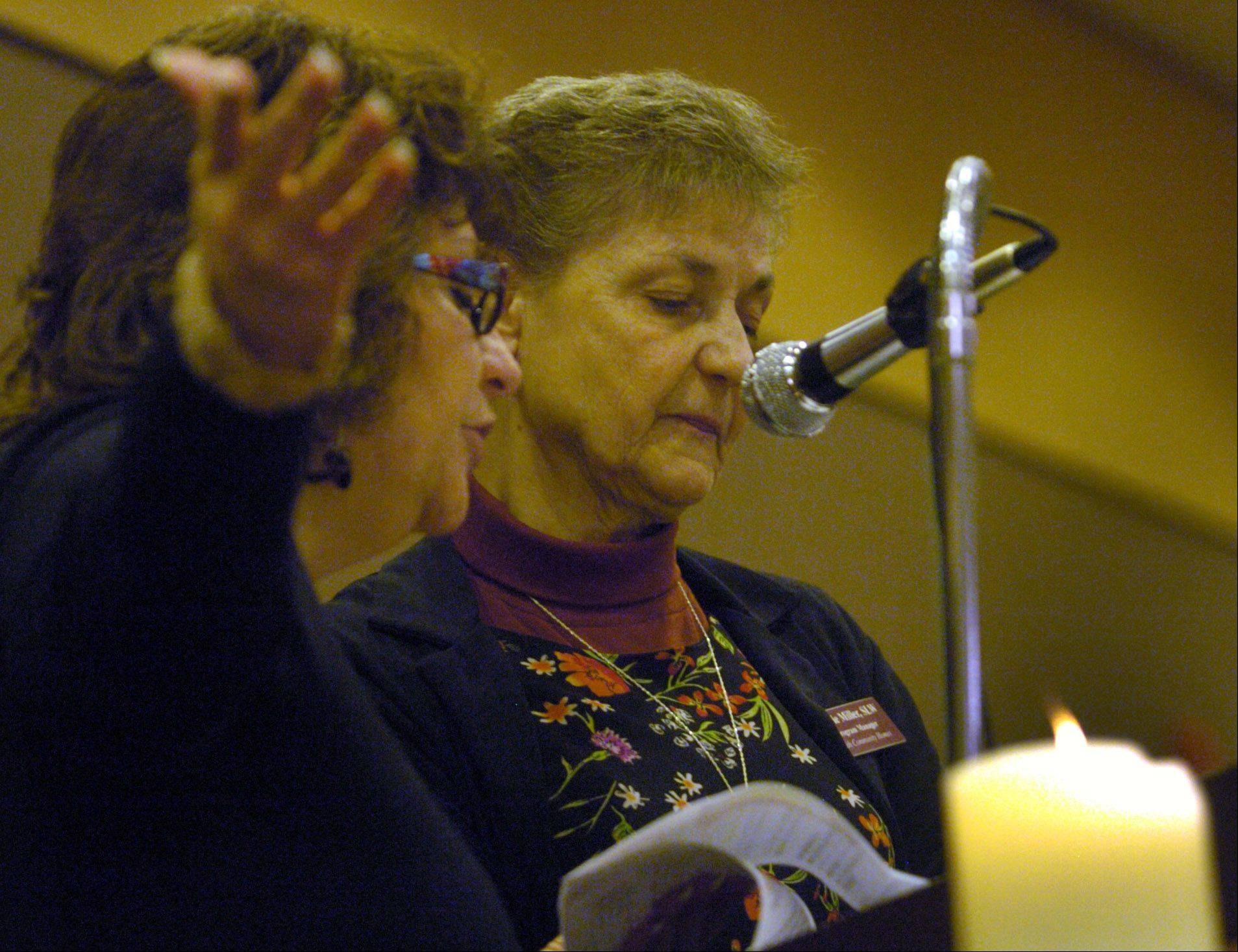 Sister Carrie Miller of the Sisters of the Living Word, and Lisa Math, left, deliver the Invocation at the Mayor's 26th annual Community Prayer Breakfast in Arlington Heights.