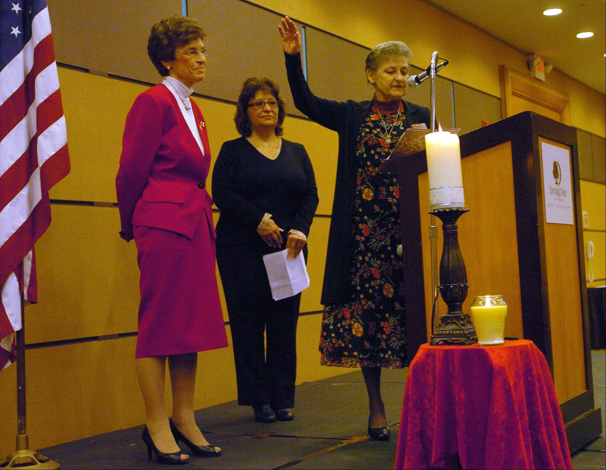 Arlene Mulder gets a blessing Thursday from Sister Carrie Miller of Sisters of the Living Word, right, and Lisa Math, center, during her final Mayor's 26th annual Community Prayer Breakfast.