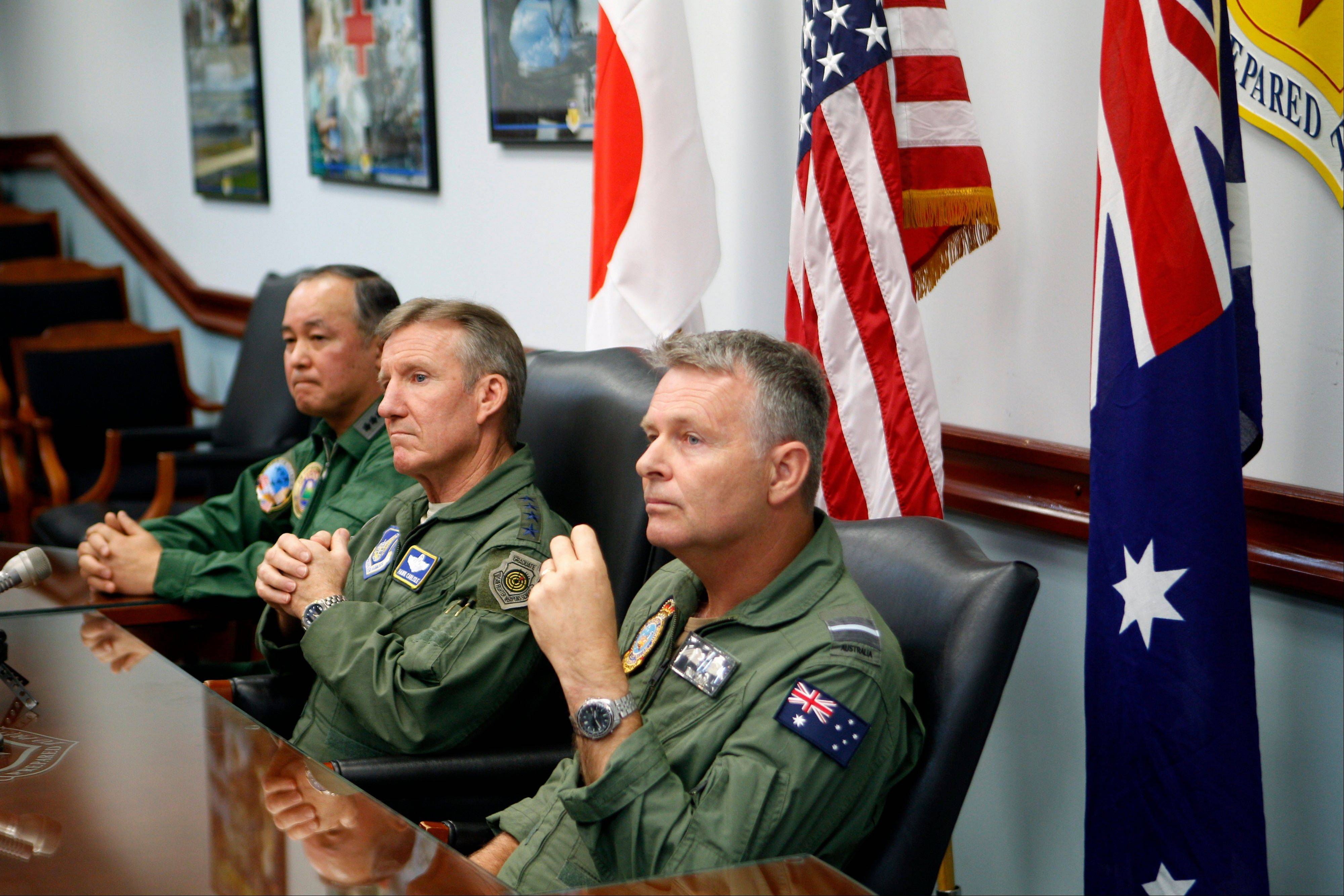 Associated PressJapanese Lt. Gen. Masayuki Hironaka, U.S. Pacific Air Forces commander Gen. Herbert Carlisle and Royal Australian Air Force Air Commodore Anthony Grady speak to the media at Andersen Air Force Base on the island of Guam to kick off the beginning of the Cope North military exercises.