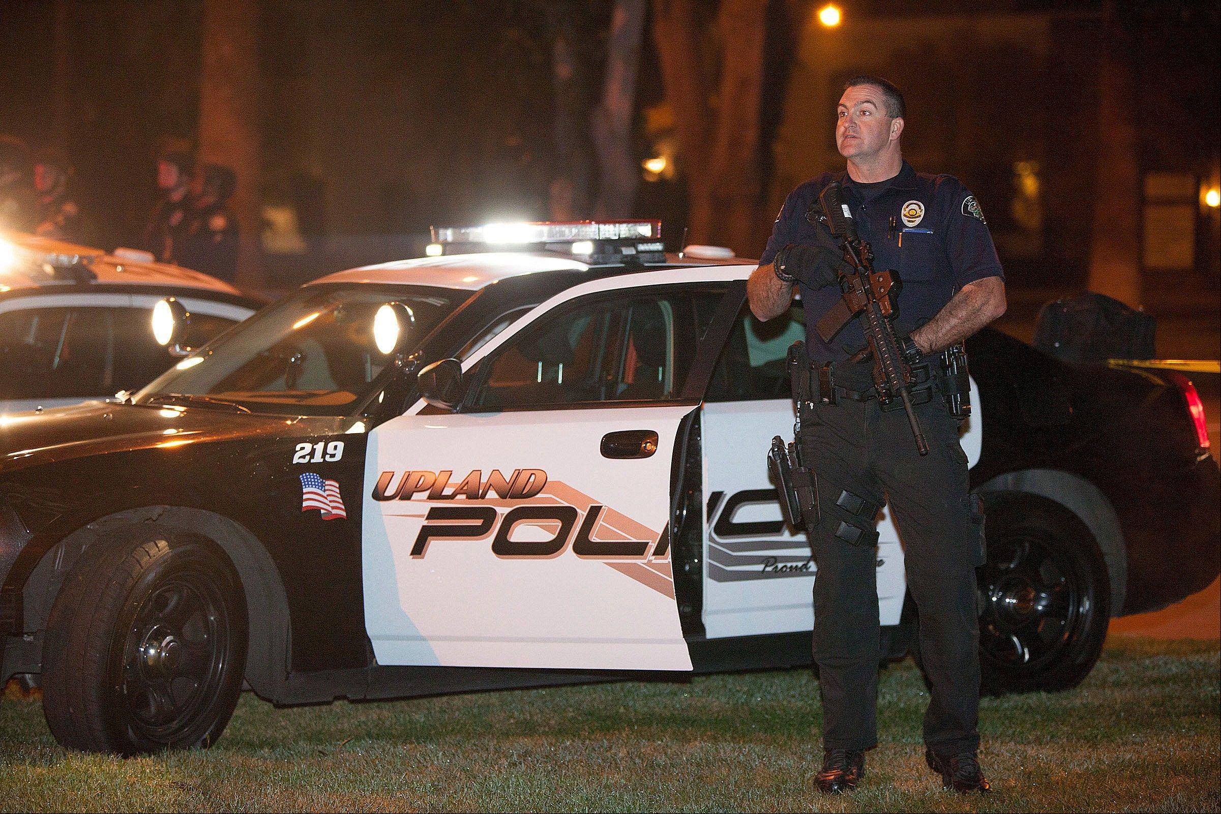Police respond in Riverside, Calif., early Thursday morning after one officer was killed and another critically wounded in a shoot out with a murder suspect.