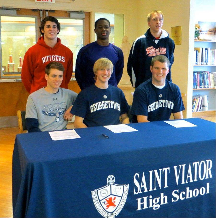 Six athletes from St. Viator committed to a future in college athletics by signing letters of intent on Wednesday. Front row, from left to right are Patrick Martin, Harry McCollum and Hugh Masterson. Back from from left are Peter Trunk, Mayo Arogundade and Gunnar Kay.